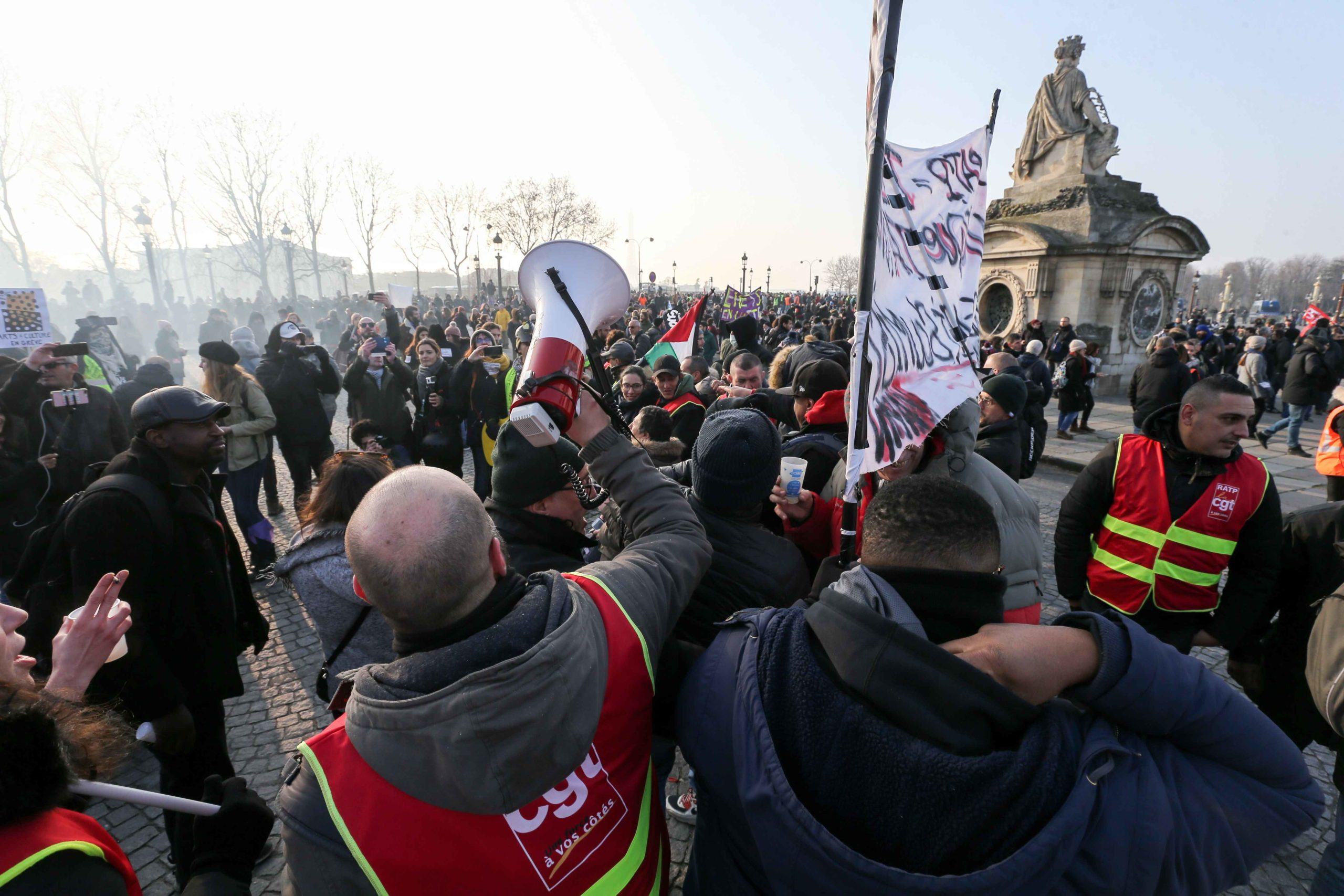 Protestors gather in Place de la Concorde during a demonstration in Paris on January 24, 2020 against the government pensions reform, which will be officially unveiled after weeks of strikes by unions warning that millions of people will have to work longe