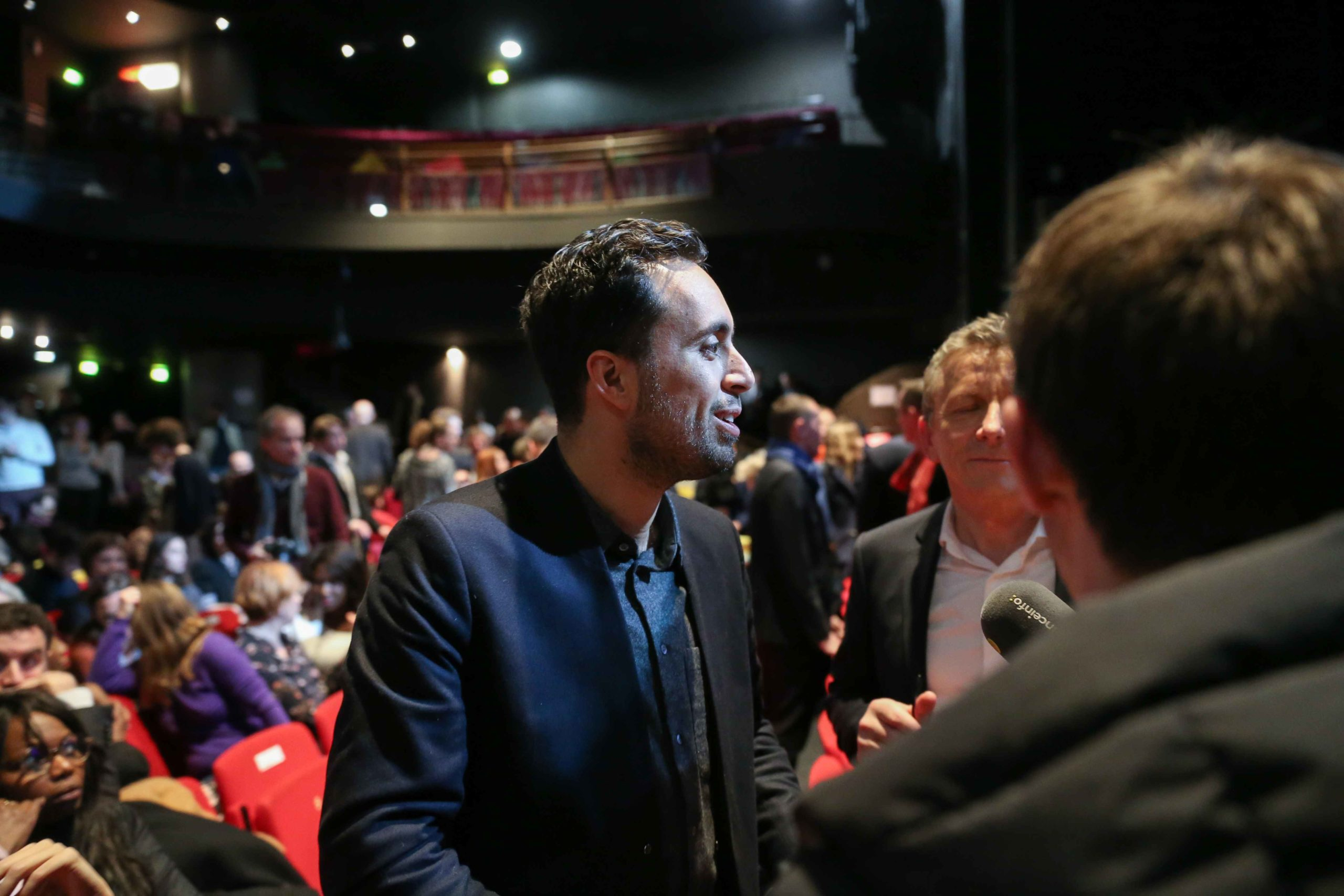 France's leftist party La France Insoumise (LFI) MP Mounir Mahjoubi (C) takes part in the Benjamin Griveaux meeting, at the Bobino theater in Paris, on January 27, 2020. Benjamin Griveaux is the official La Republique en Marche (LREM) candidate for the Par