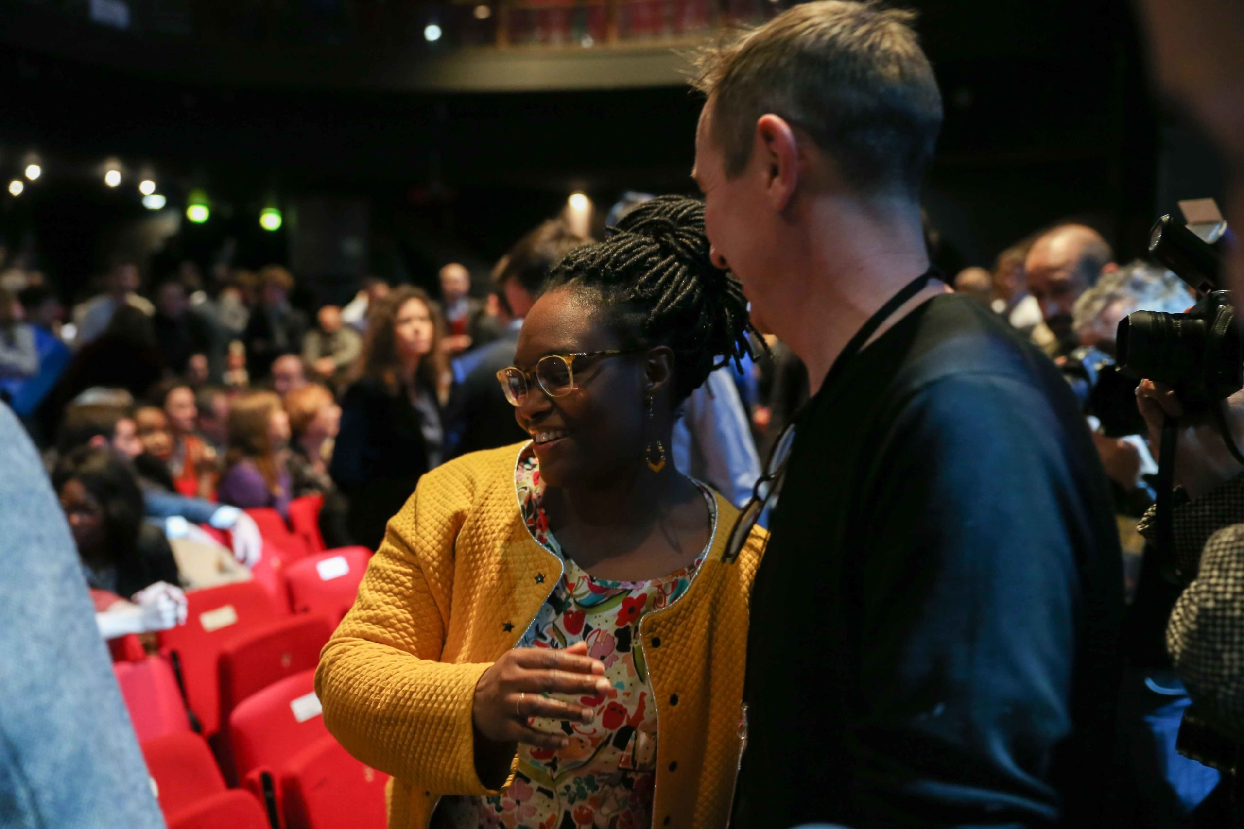 French Junior Minister and Government's spokesperson Sibeth NDiaye (C) takes part in the Benjamin Griveaux meeting, at the Bobino theater in Paris, on January 27, 2020. Benjamin Griveaux is the official La Republique en Marche (LREM) candidate for the Pari