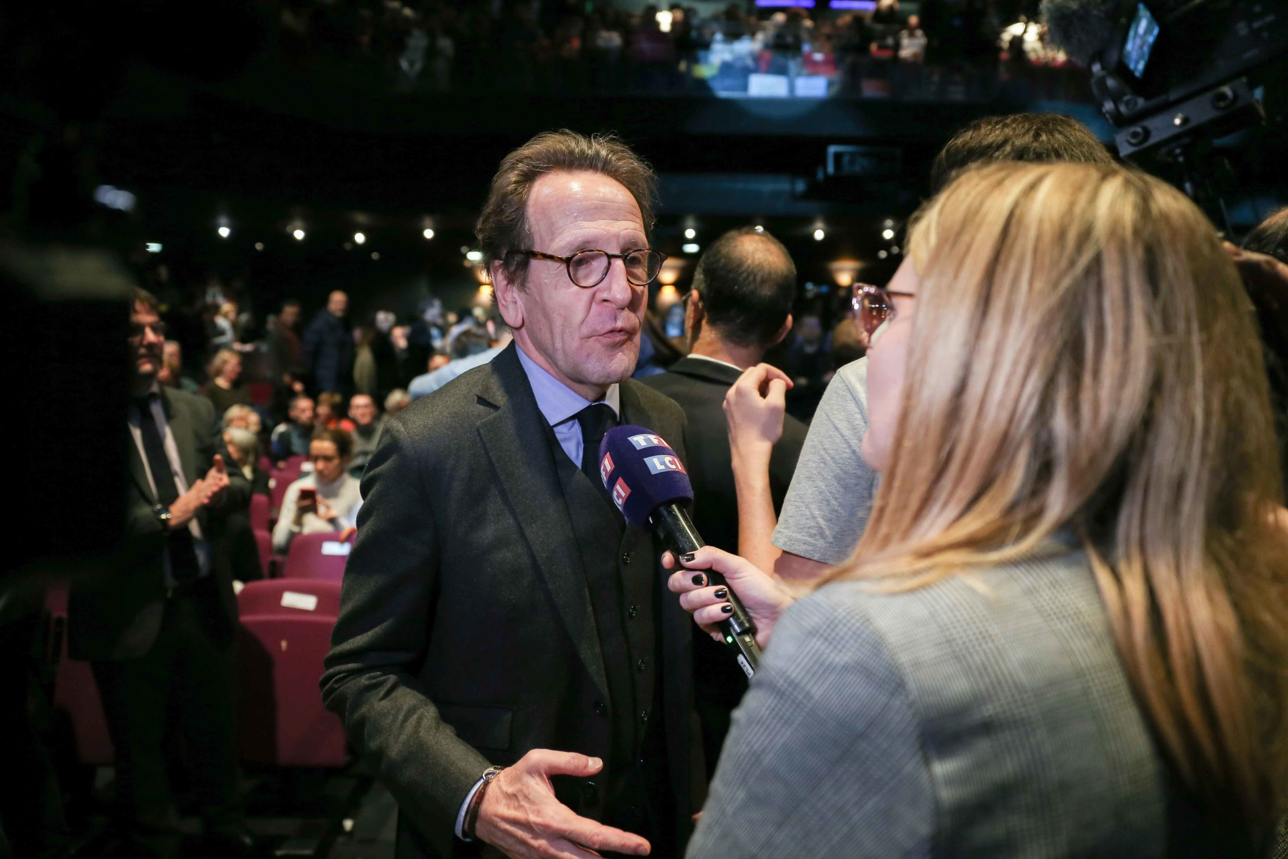 La Republique en Marche (LREM) group president at the National Assembly Gilles Le Gendre (C) takes part in the Benjamin Griveaux meeting, at the Bobino theater in Paris, on January 27, 2020. Benjamin Griveaux is the official LREM candidate for the Paris 20