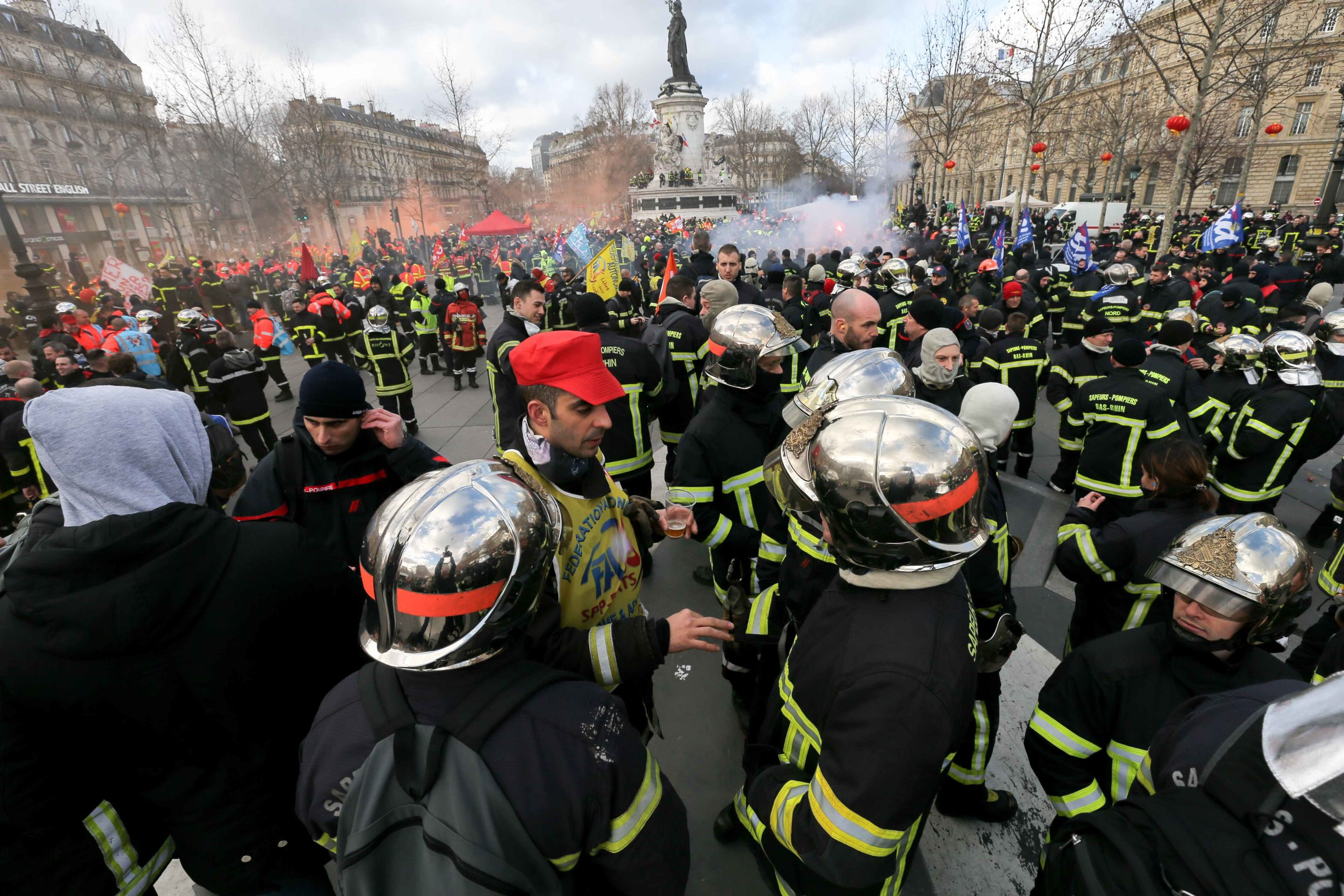 Firefighters gather at Republic Square as they take part in a demonstration to protest against French government's plan to overhaul the country's retirement system in Paris, on January 28, 2020.