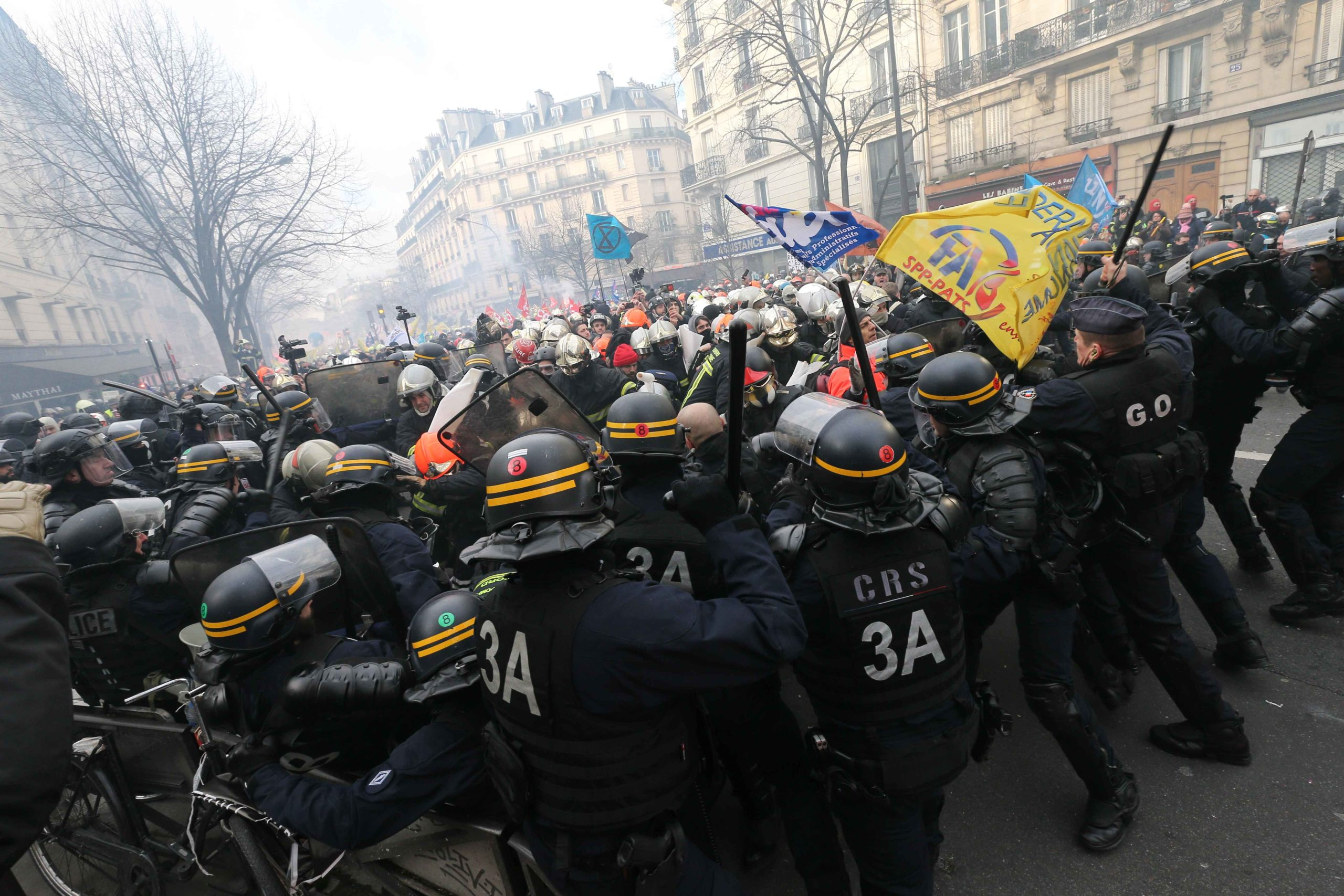 French police clash with firefighters protesting against French government's plan to overhaul the country's retirement system in Paris, on January 28, 2020.