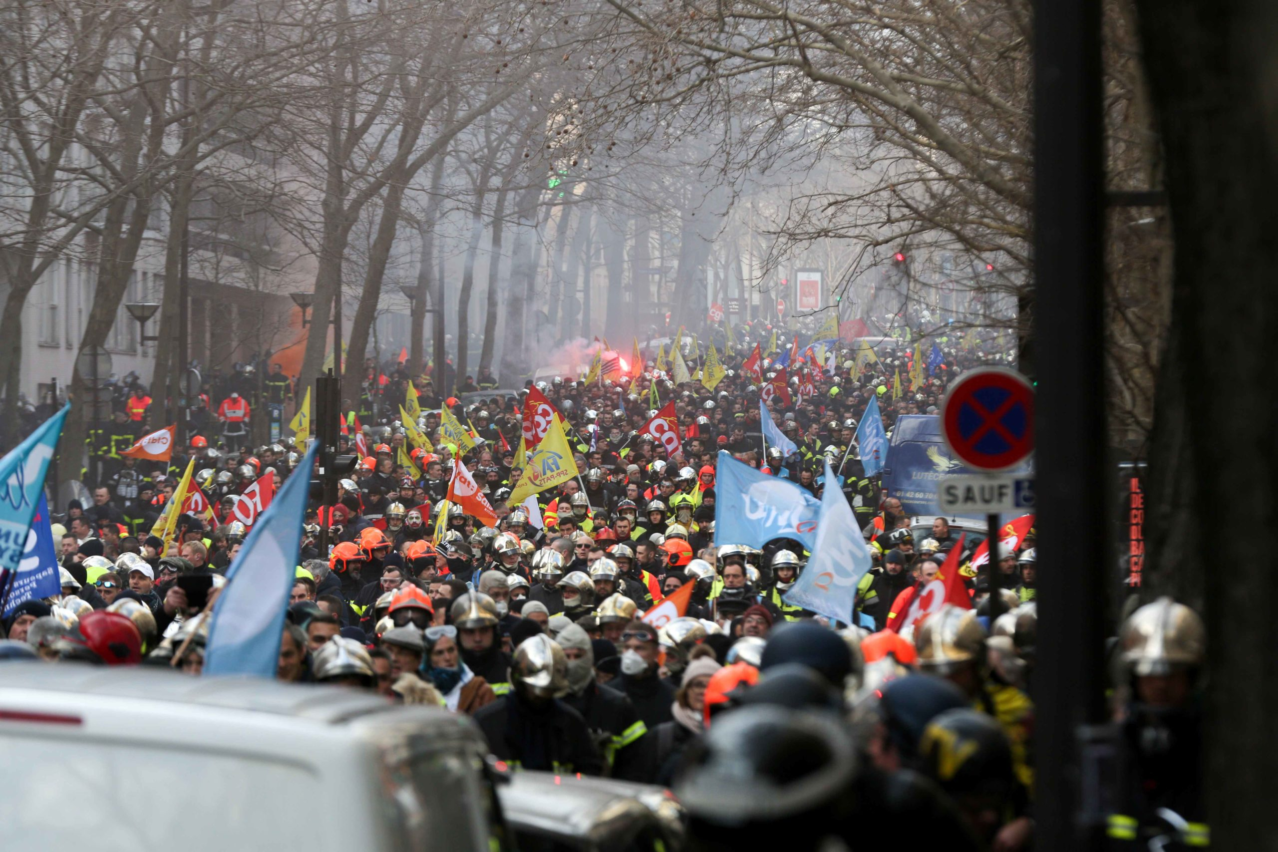 Firefighters march during a demonstration to protest against French government's plan to overhaul the country's retirement system in Paris, on January 28, 2020.