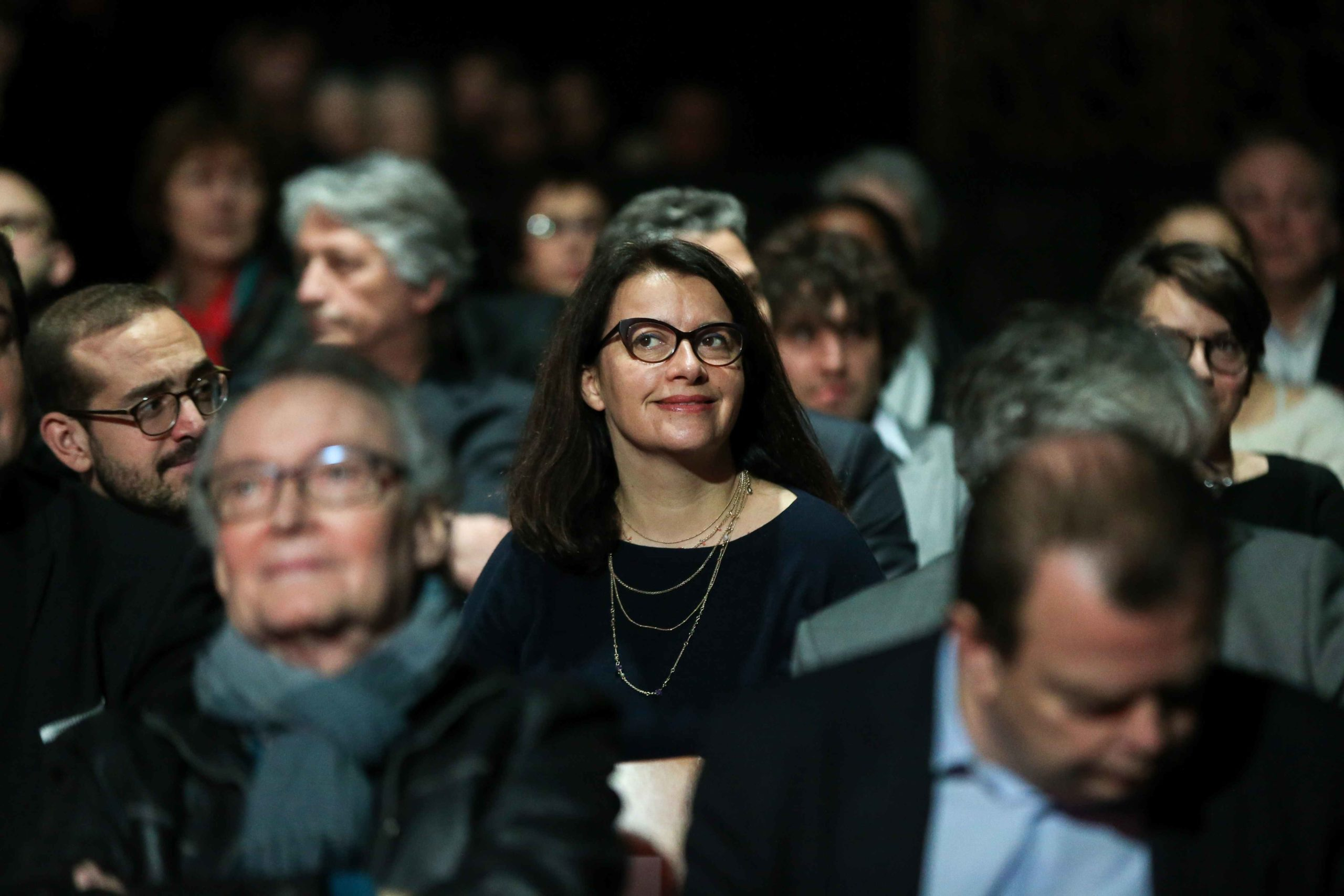 French Former Ecology minister and Head of Oxfam France Cecile Duflot (C) takes part in a report of the Abbe Pierre Foundation on poor quality housing conditions, on January 31, 2020 in La Defense, near Paris.