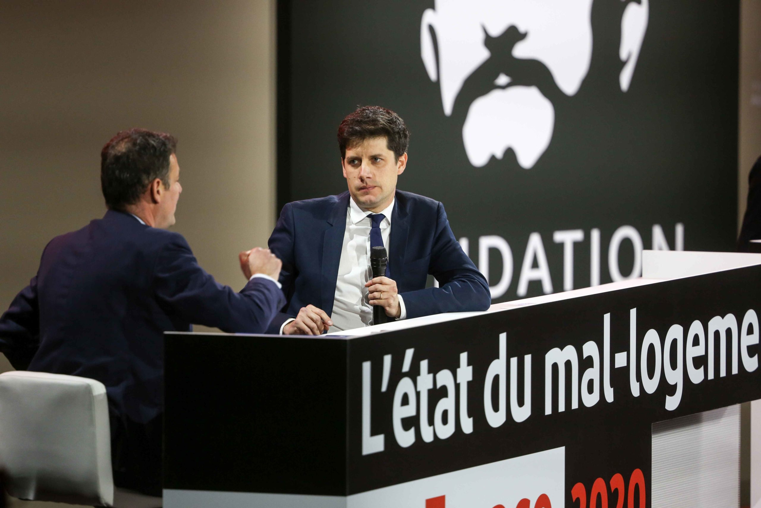 French Junior Minister for Cities and Housing Julien Denormandie (C) takes part in a debate during a report of the Abbe Pierre Foundation on poor quality housing conditions, on January 31, 2020 in La Defense, near Paris.