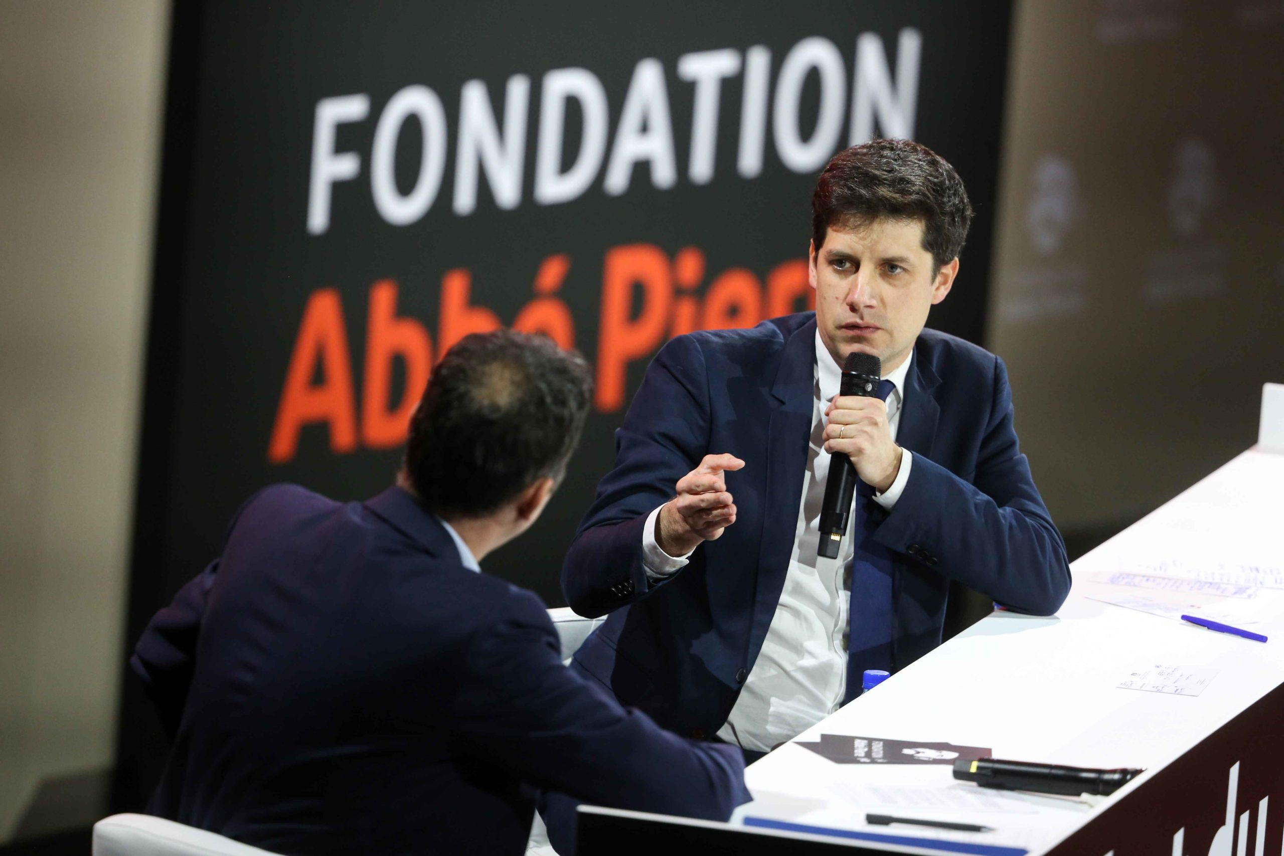 French Junior Minister for Cities and Housing Julien Denormandie (R) takes part in a debate during a report of the Abbe Pierre Foundation on poor quality housing conditions, on January 31, 2020 in La Defense, near Paris.