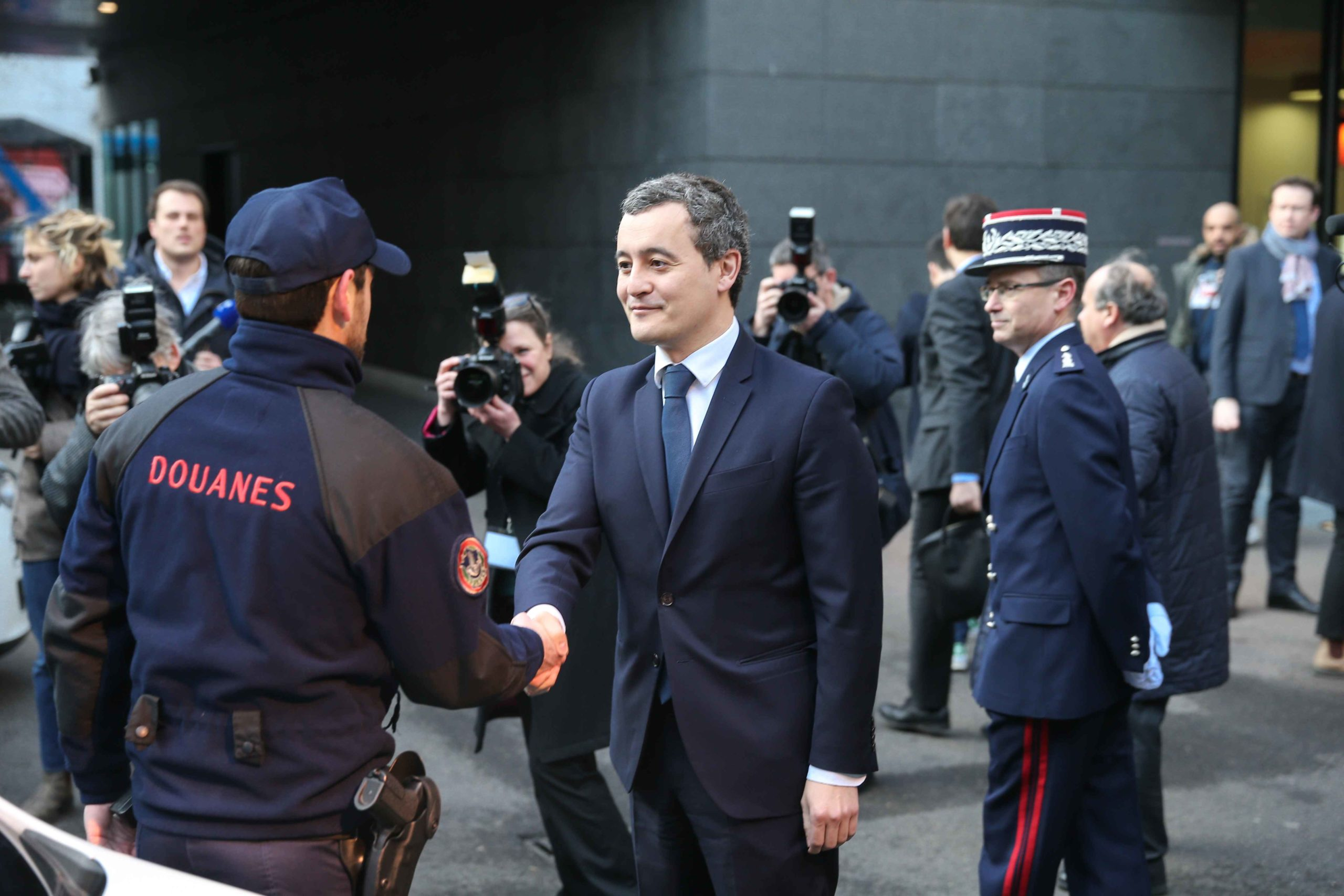 French Minister of Public Action and Accounts Gerald Darmanin (C) arrives at the Paris regional customs service on February 04, 2020 to present the 2019 results of the National plan to mobilise customs against the trafficking of tobacco and cigarettes.