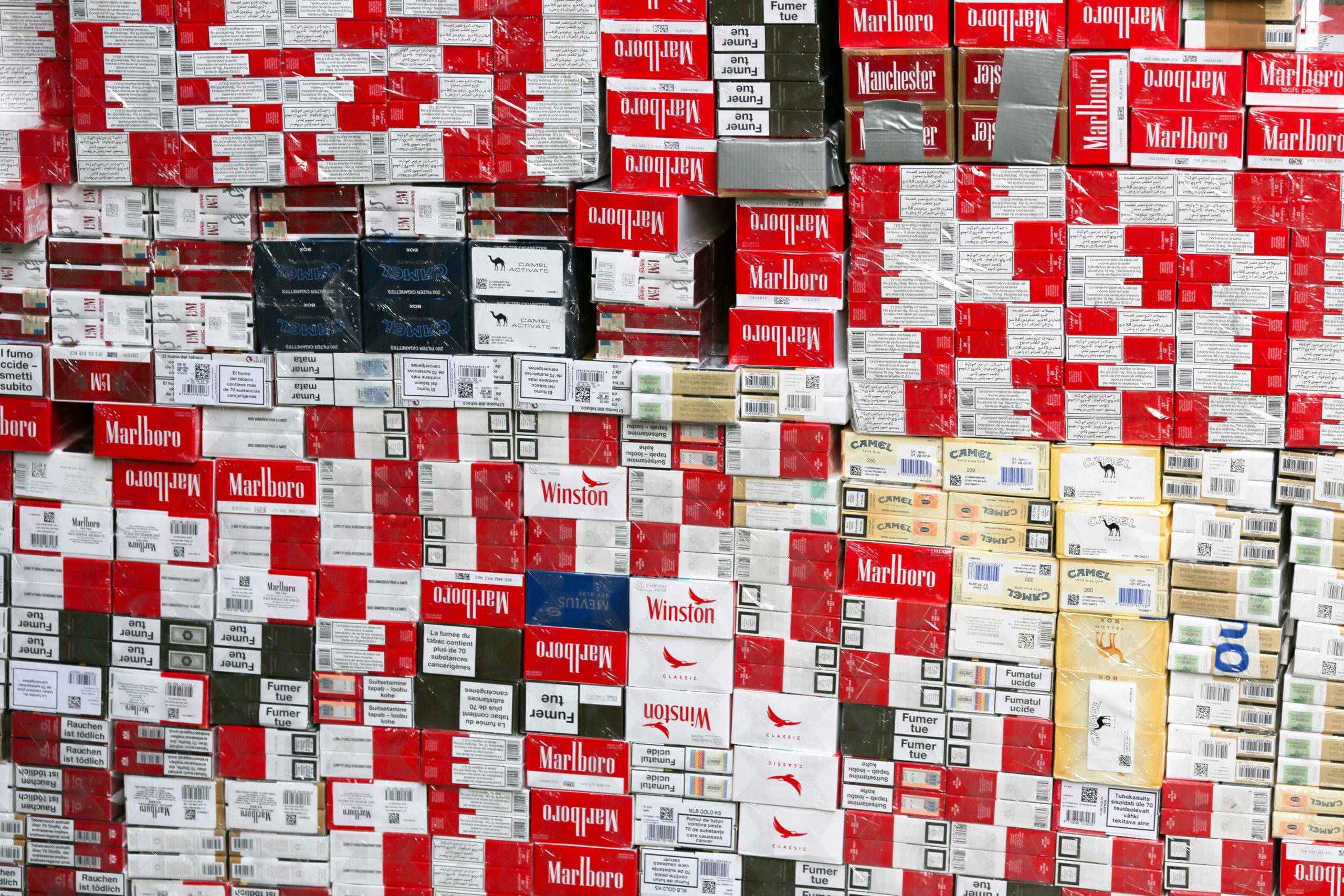 Illegal cigarettes are exhibited to the press in the Paris regional customs service on February 04, 2020, during a presentation of the 2019 results of the National plan to mobilise customs against the trafficking of tobacco and cigarettes by French Ministe