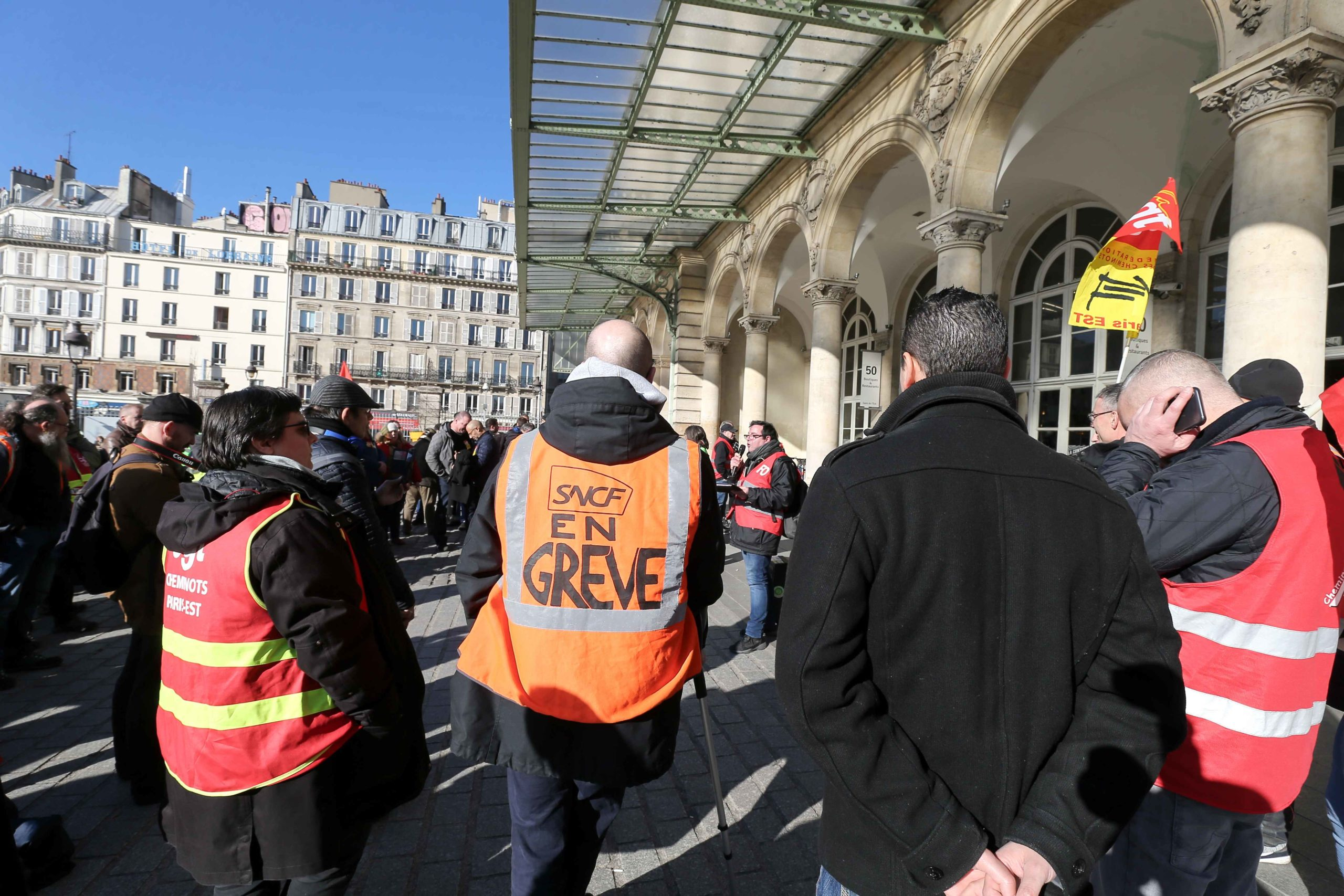 Railway workers gather in front the East railway station, in Paris, for a general assembly, on 6 February 6, 2020, during a ninth inter-professional day of strikes and demonstrations since early December 2019 against the French government's pensions overha