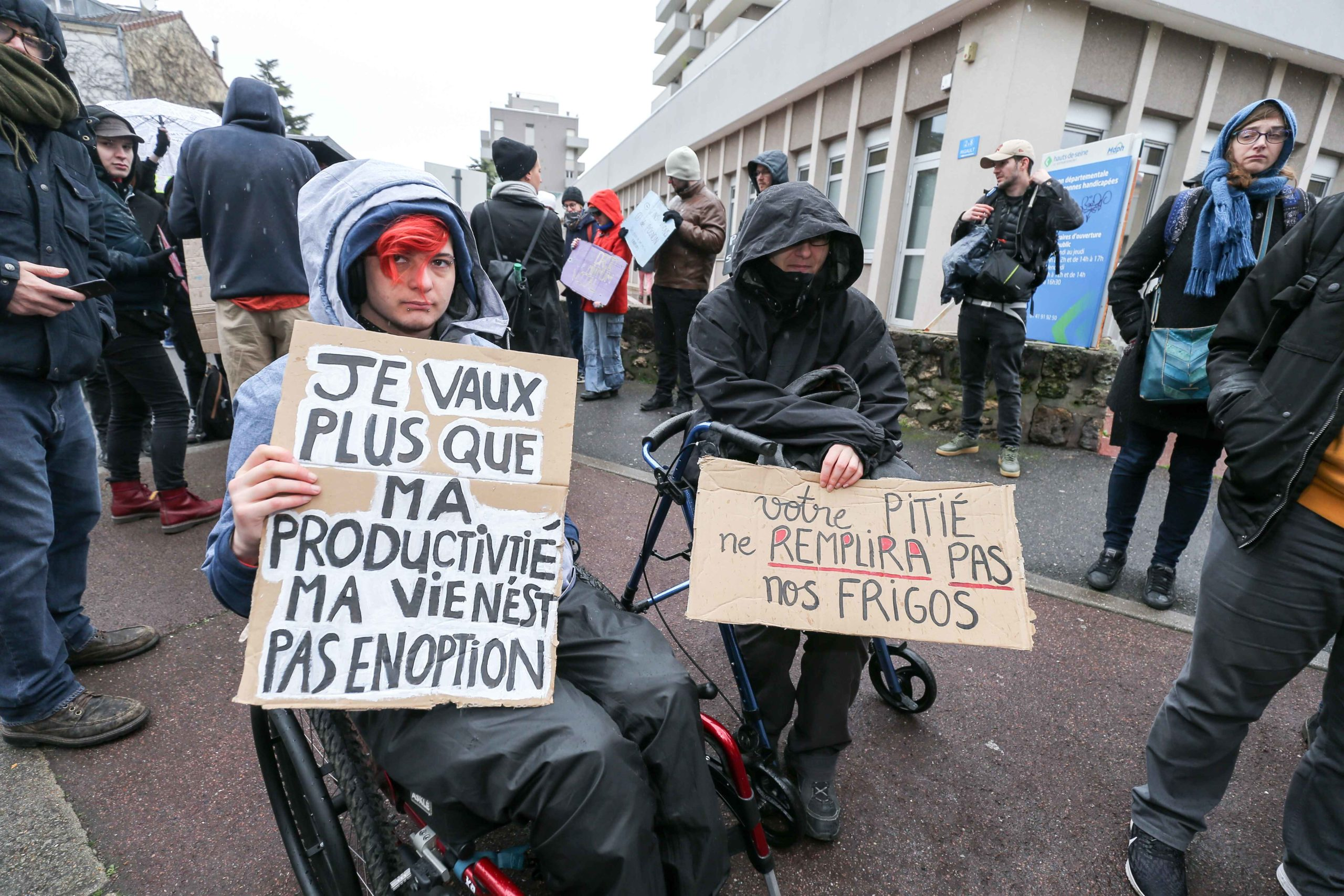Persons in a wheelchair demonstrate for a greater inclusion of people with disabilies in front of the Departemental Center for Disabled Persons (Maison départementale des personnes handicapées MDPH) in Nanterre, in the inner suburbs of Paris, on February