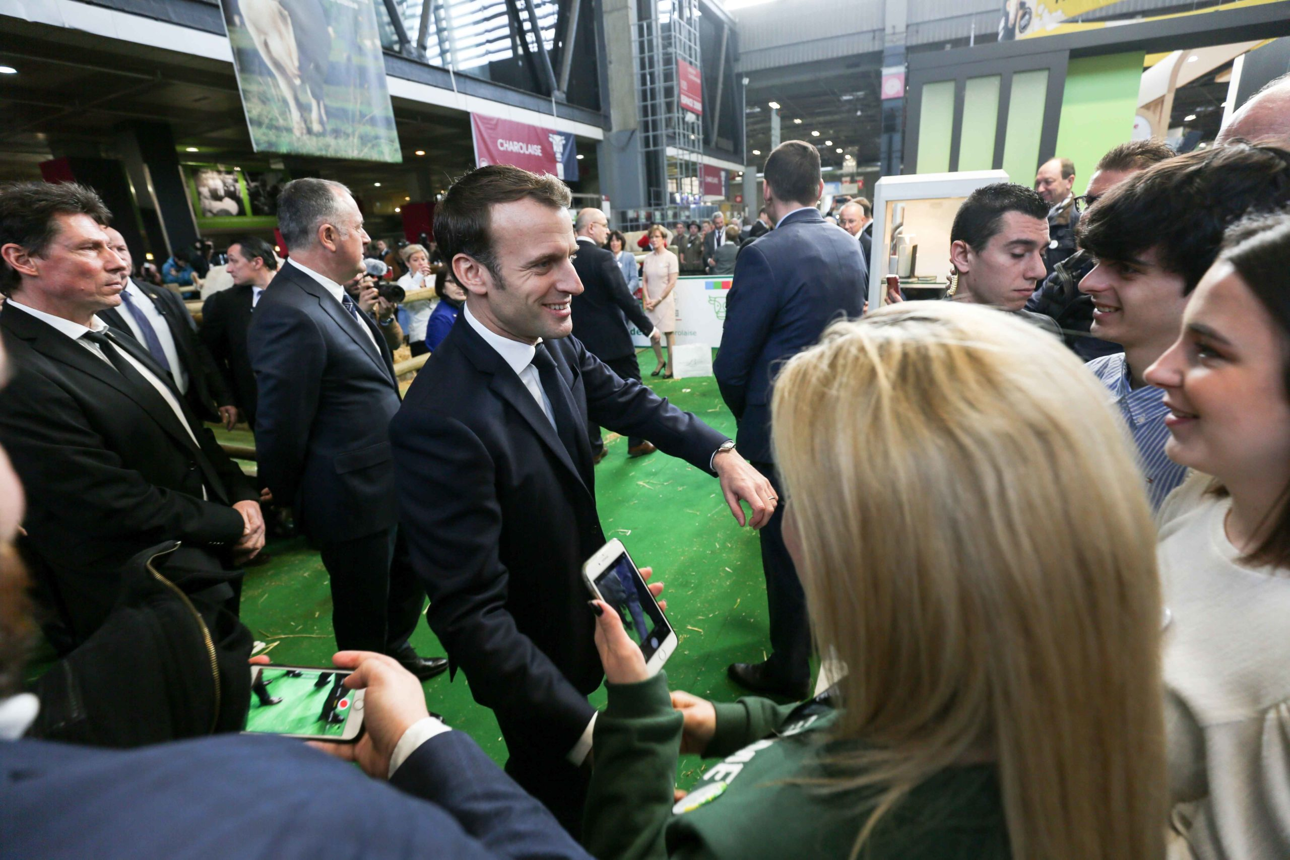 French President Emmanuel Macron (C) visits the 57th International Agriculture Fair (Salon de l'Agriculture) at the Porte de Versailles exhibition center in Paris, France, on February 22, 2020.