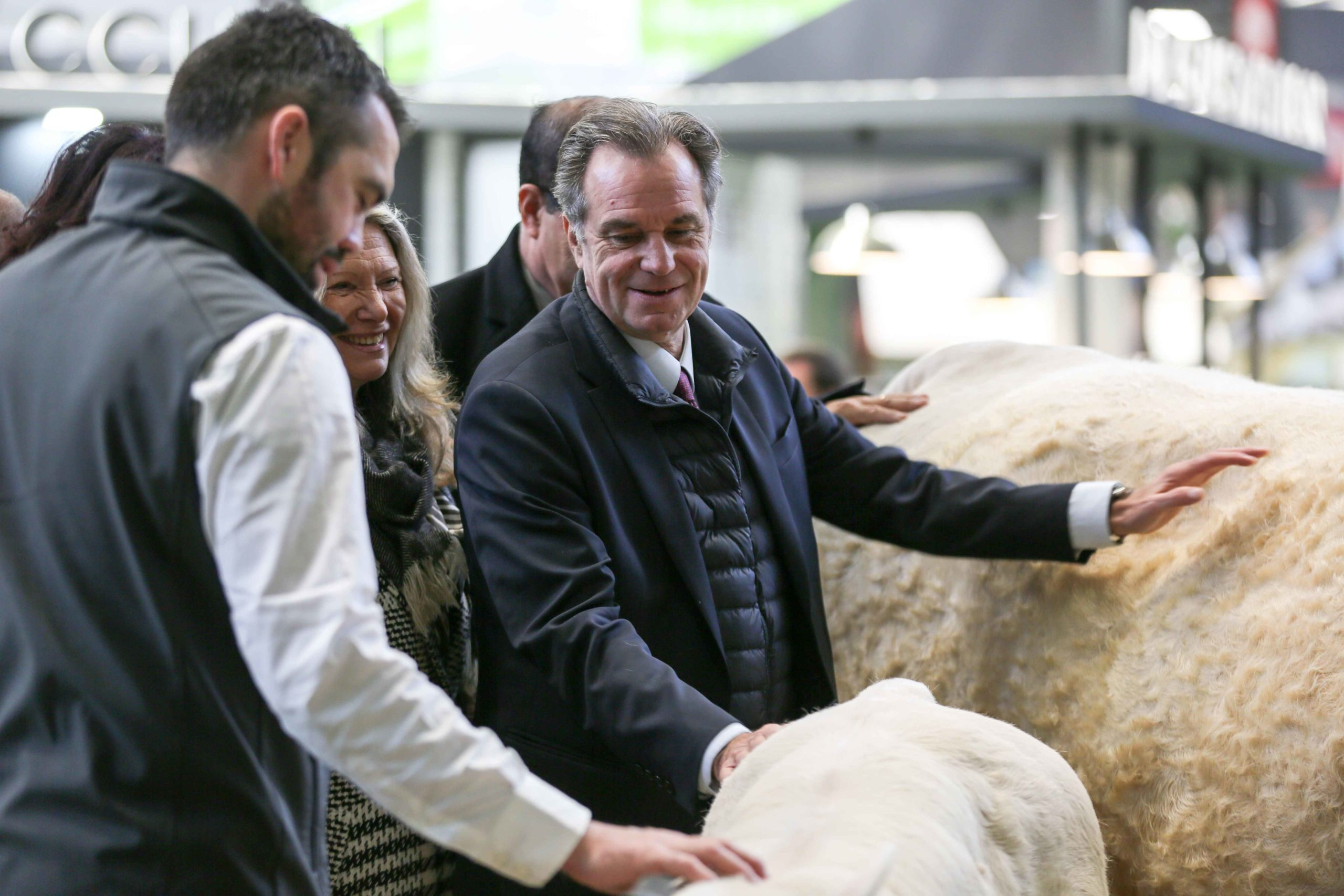 The President of the Regional Council of the Provence-Alpes-Cote-d'Azur region Renaud Muselier (C) visits the international Agriculture Fair in Paris on February 25, 2020.