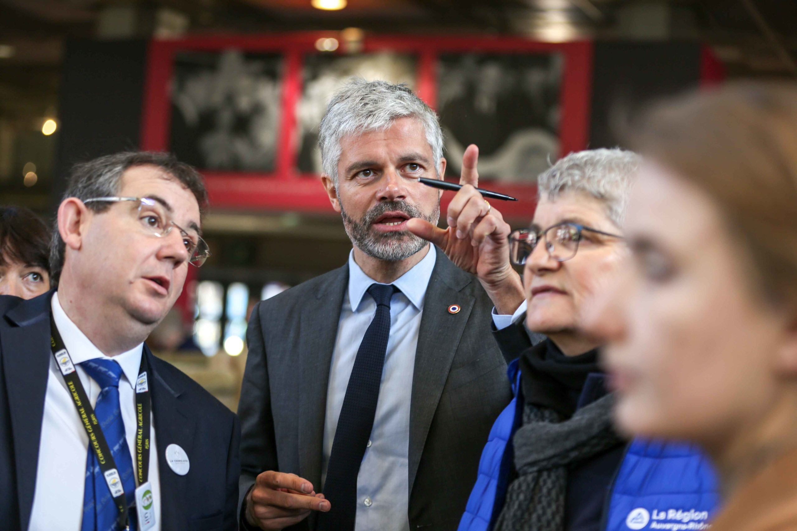 President of France's administrative region Auvergne-Rhone-Alpes Laurent Wauquiez (C) visits the international Agriculture Fair in Paris on February 25, 2020.