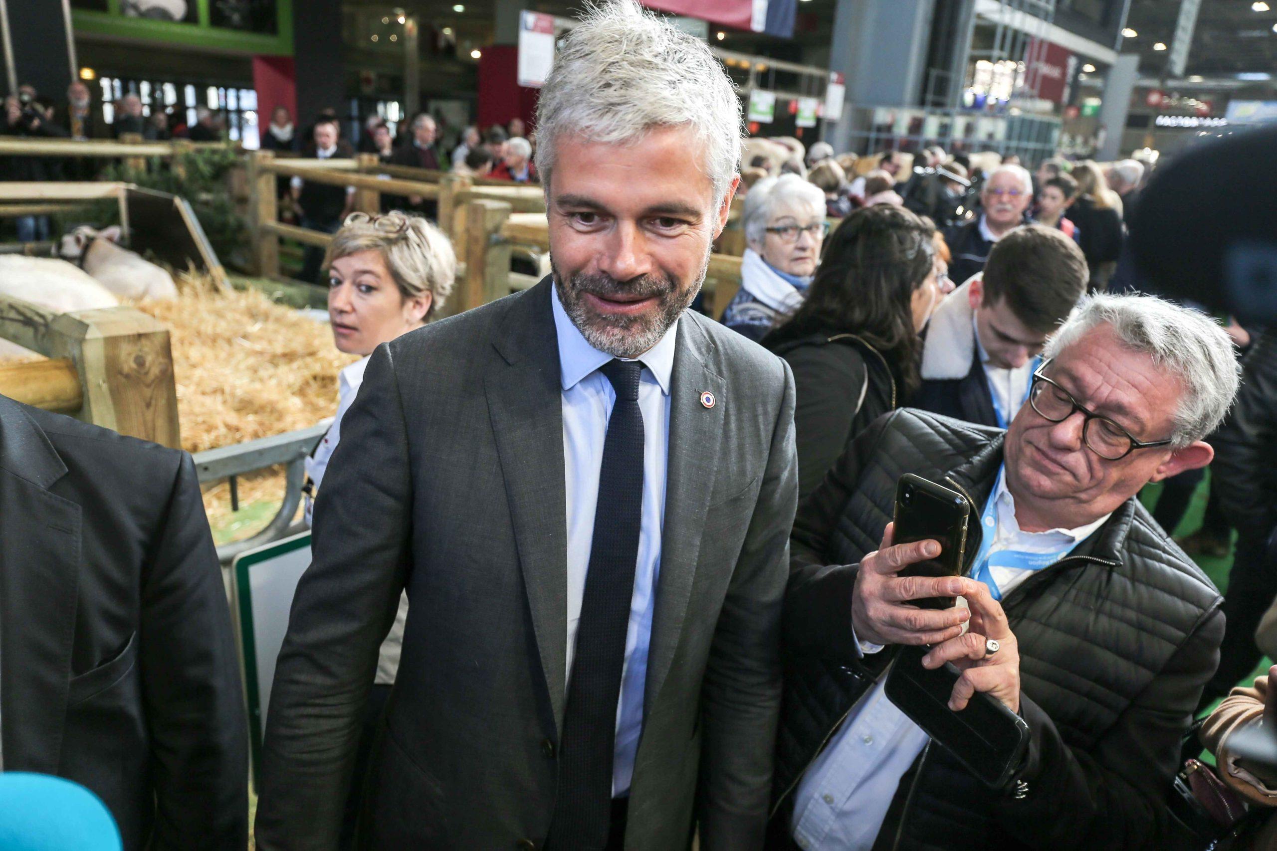 President of France's administrative region Auvergne-Rhone-Alpes Laurent Wauquiez (C) visits the international Agriculture Fair in Paris on February 25, 2020.
