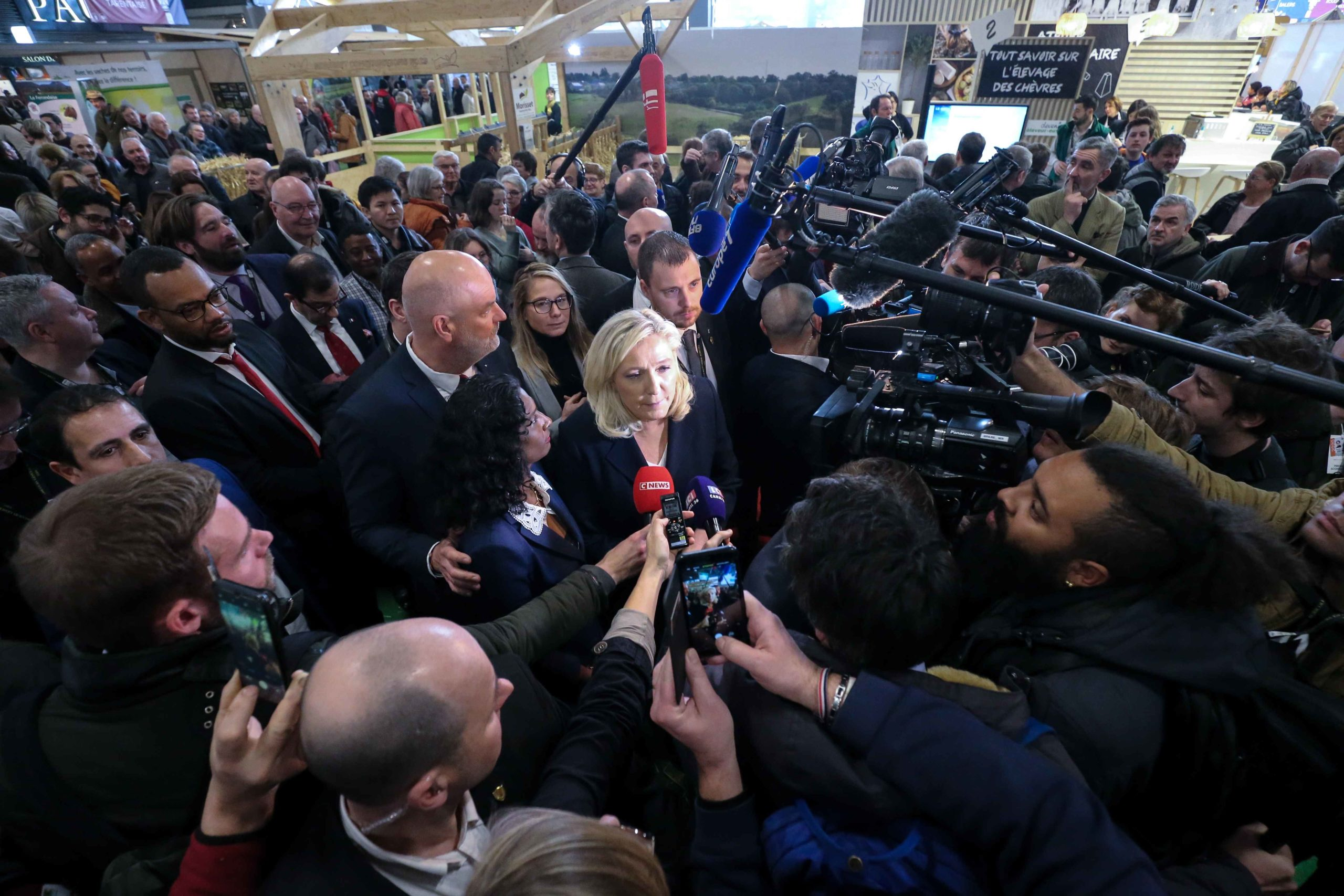 French member of Parliament and President of the far-right Rassemblement National (RN) party Marine Le Pen (C) visits the international Agriculture Fair in Paris with French far-right party Rassemblement National (RN) eurodeputies Maxette Pirbakas (C-L) on