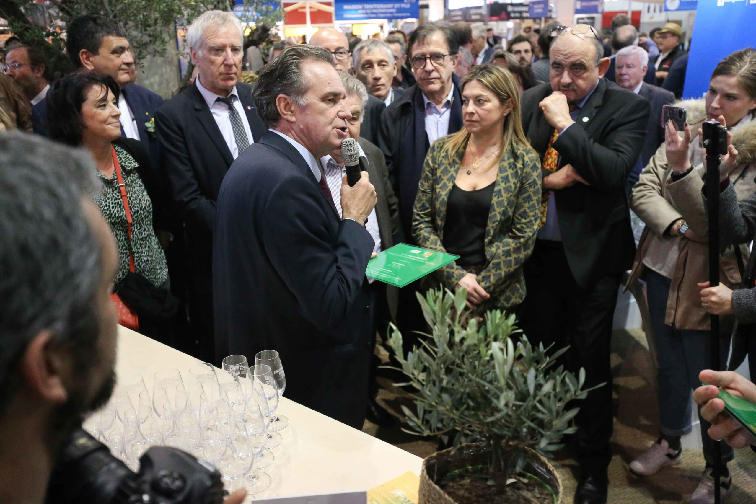 The President of the Regional Council of the Provence-Alpes-Cote-d'Azur region Renaud Muselier (C-L) speaks during the international Agriculture Fair in Paris on February 25, 2020.