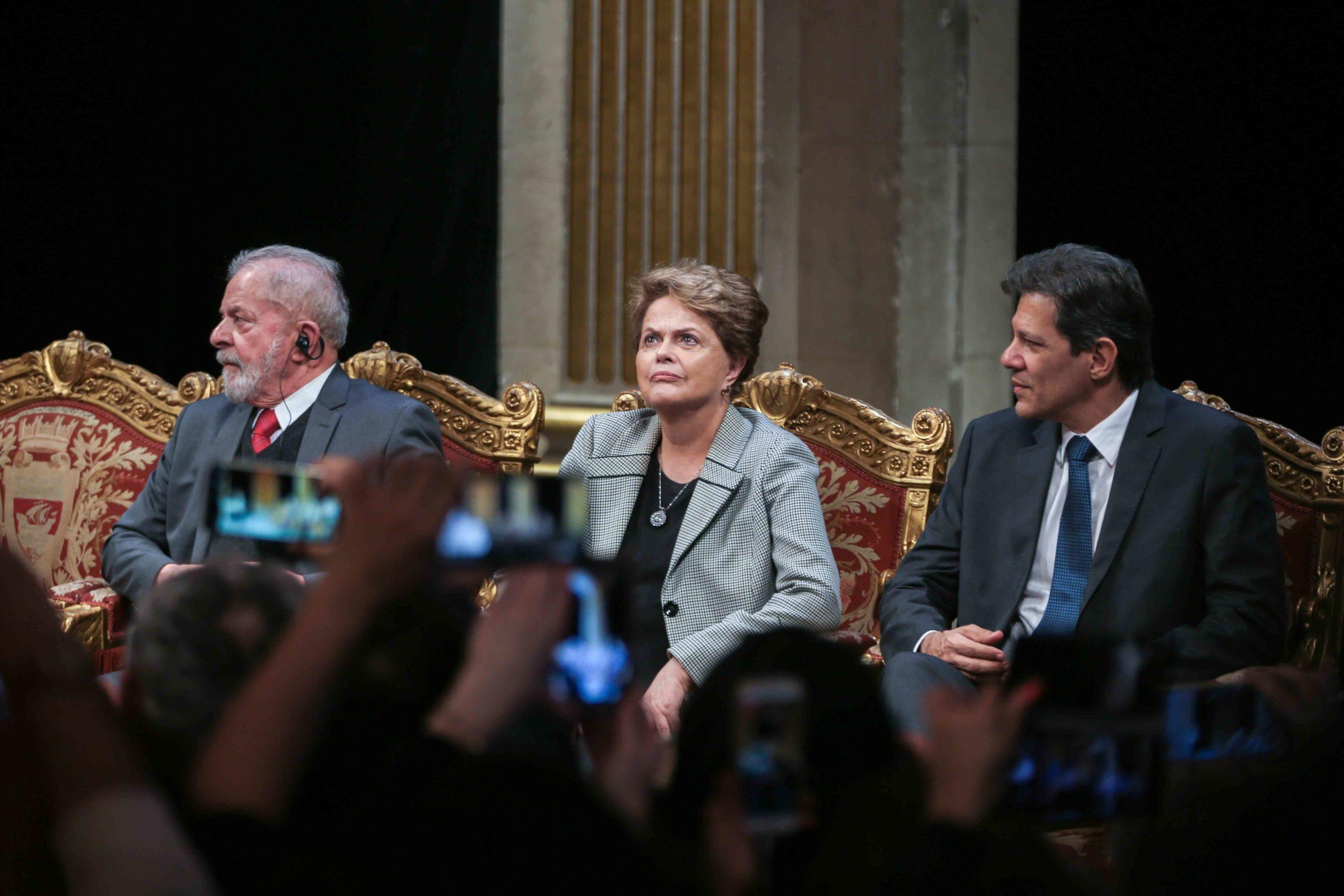 (Lto R) Former Brazilian president Luiz Inacio Lula da Silva, Former Brazilian president Dilma Rousseff and former Sao Paolo Mayor Fernando Hadda take part in a ceremony at the City Hall of Paris, on March 2, 2020, during wich the President Lula da Silva w