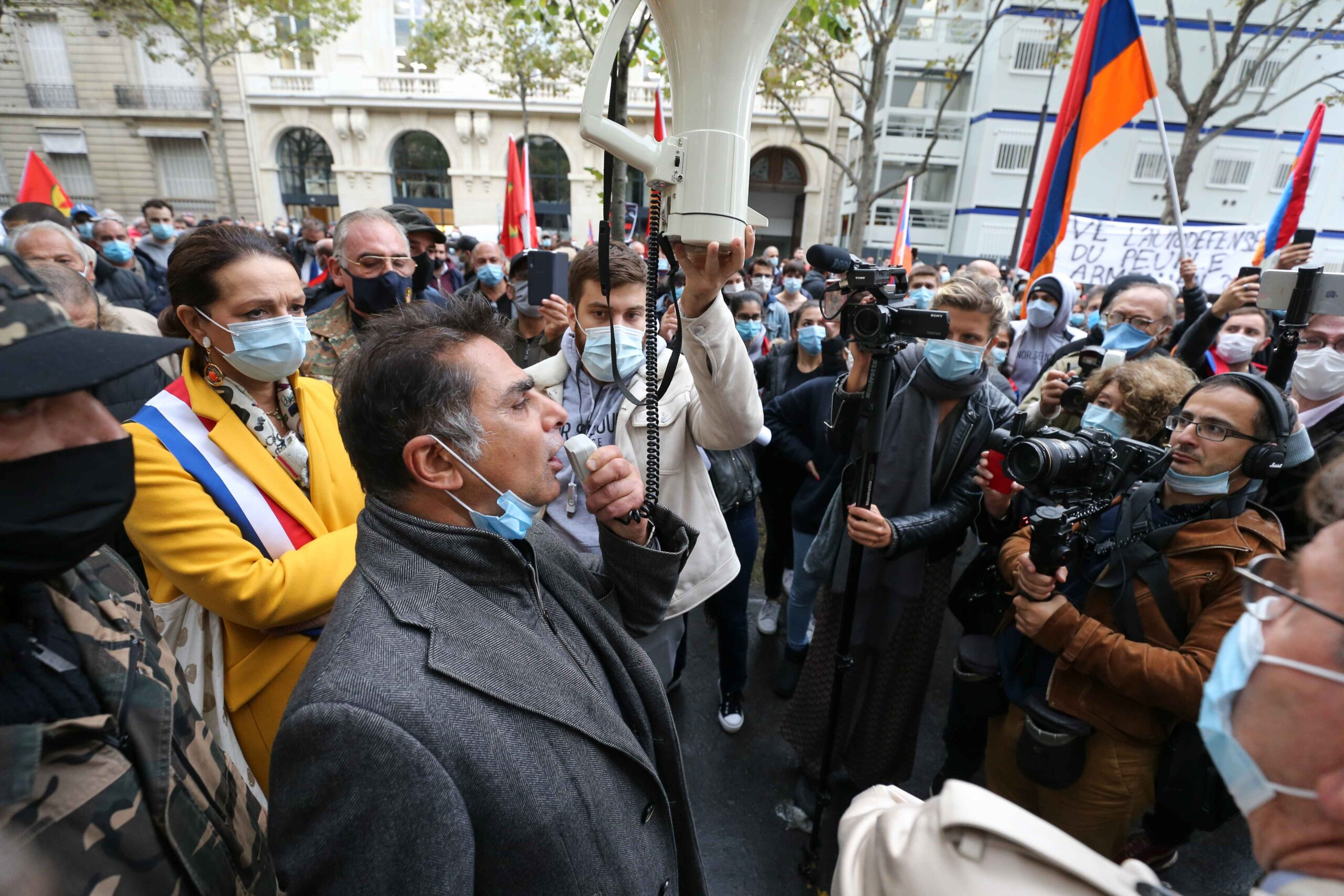 Mourad Franck Papazian (3L), the co-president of the Coordination Council of Armenian organisations of France (CCAF), the representative body of the French-Armenian community, addresses the demonstrators during a demonstration of Armenians in front of the