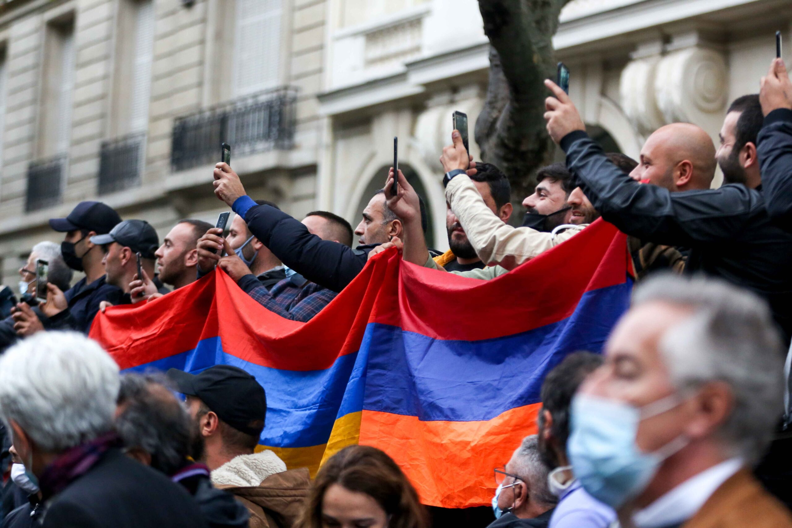 Men hold a flag of Armenia during a demonstration of Armenians in front of the Azerbayan ambassy in Paris, France, on September 29, 2020 against the Azerbayan attacks on Nagorno Karabakh.