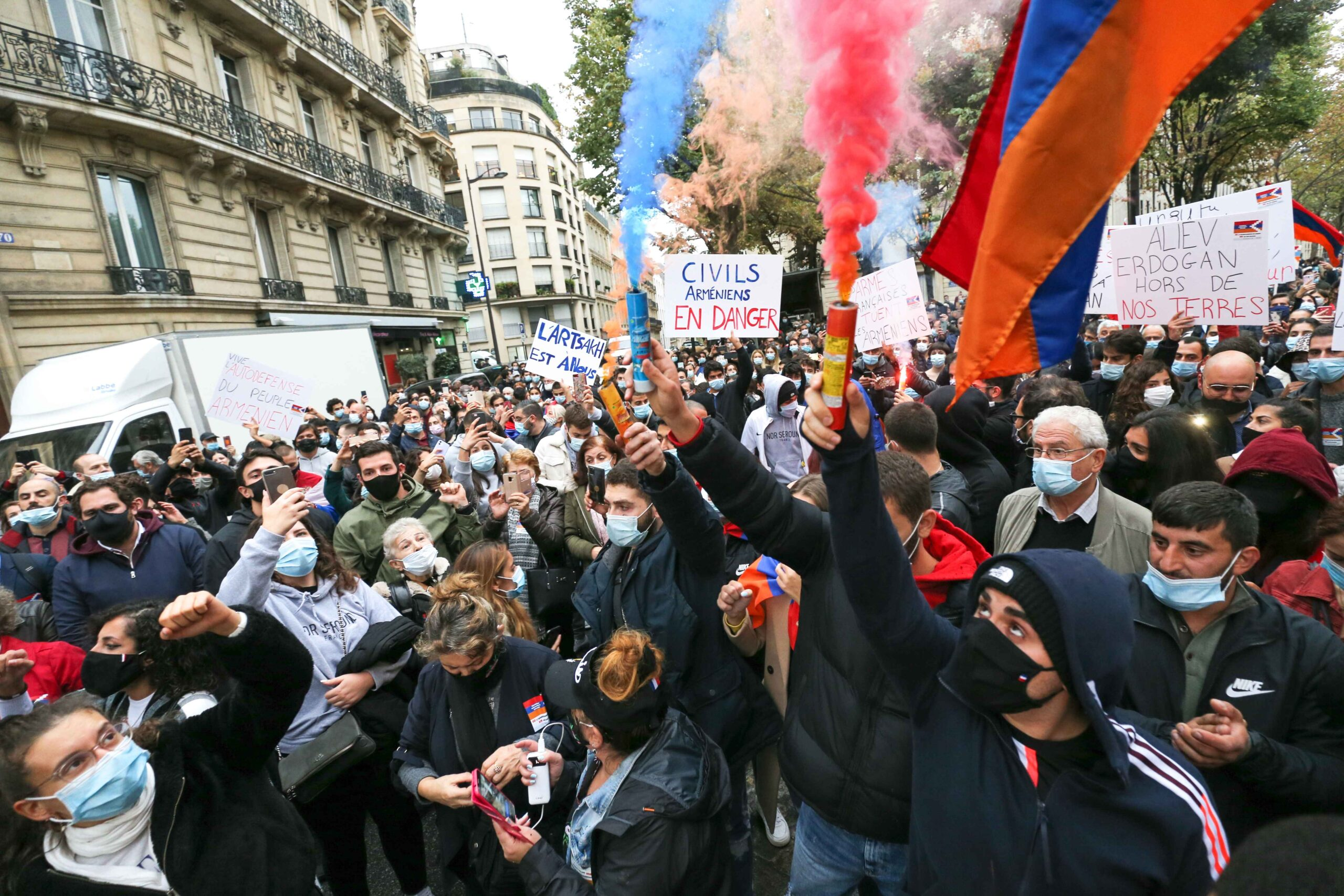 Armenians, carrying smoke bombs and flags in the colors of Armenia take part in a demonstration of Armenians in front of the Azerbaijan ambassy in Paris, France, on September 29, 2020 against the Azerbayan attacks on Nagorno Karabakh.