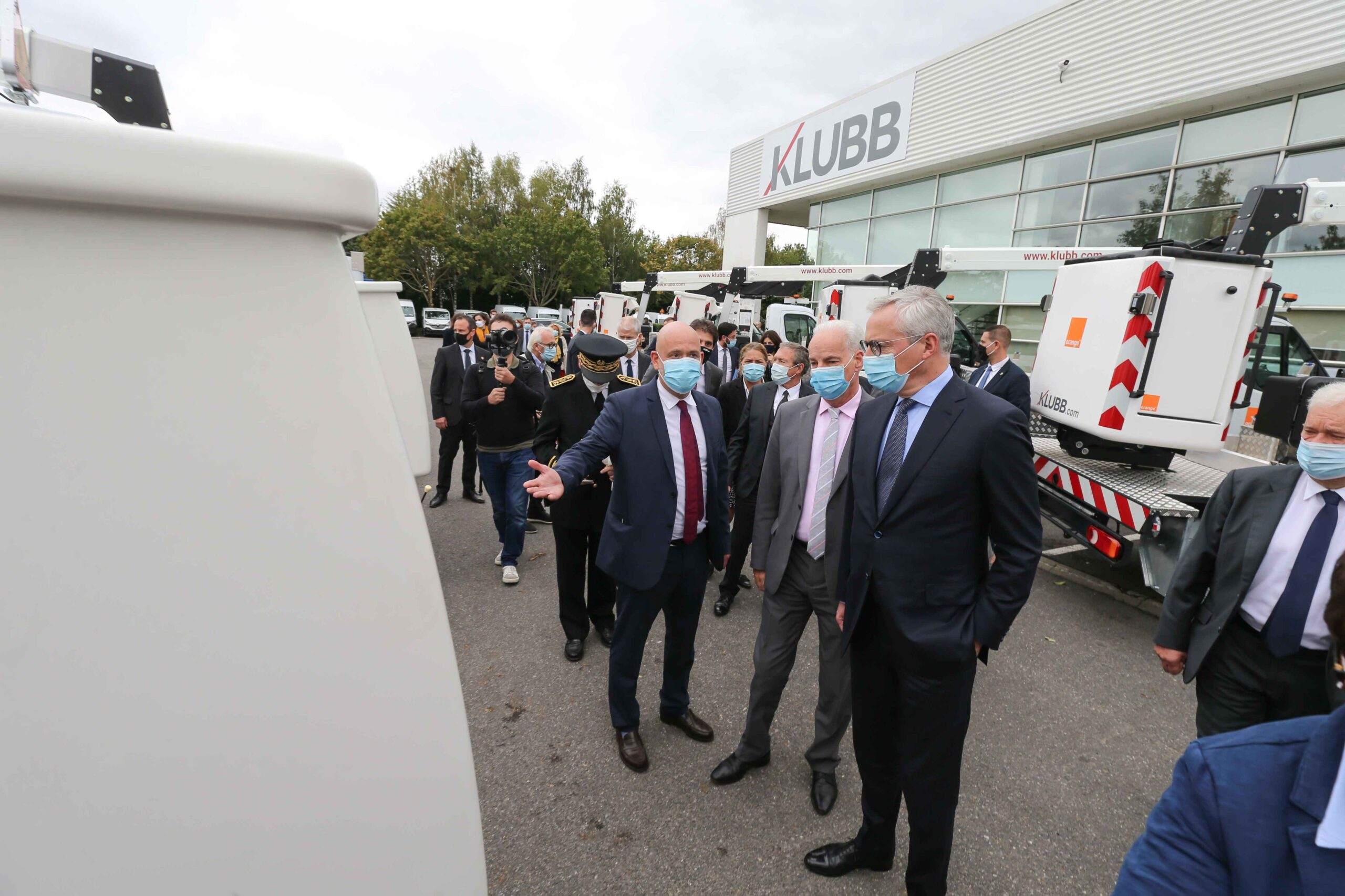 French Economy Minister Bruno Le Maire (R) and French Junior Minister of Small and Medium Entreprises Alain Griset (C), accompanied by Julien Bourrellis (L), Klubb Group CEO visit  the Klubb aerial platform production site  dedicated to the manufacture of