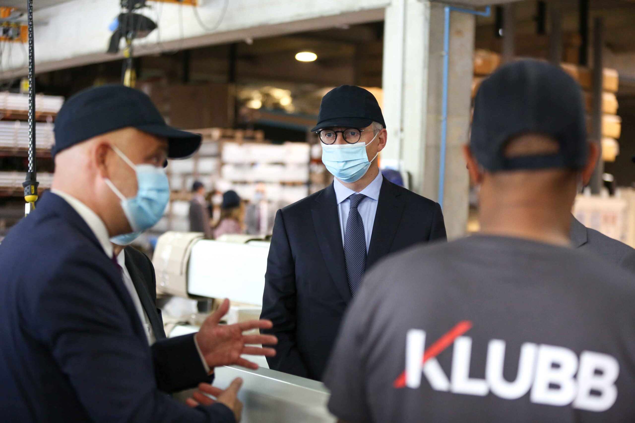 French Economy Minister Bruno Le Maire (C), accompanied by Julien Bourrellis (L), Klubb Group CEO visits  the Klubb aerial platform production site  dedicated to the manufacture of aerial platforms mounted on vans, located in Ferrières-en-Brie, just outsi