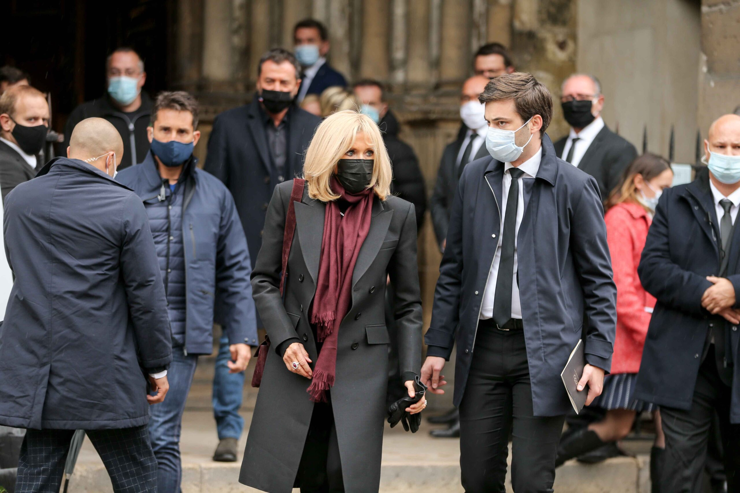 French President's wife Brigitte Macron (C) leaves after attending the funerals of French singer Juliette Greco, at the Saint-Germain-des-Pres church in Paris, on October 5, 2020. Legendary French singer Juliette Greco whose career spanned over half a cent