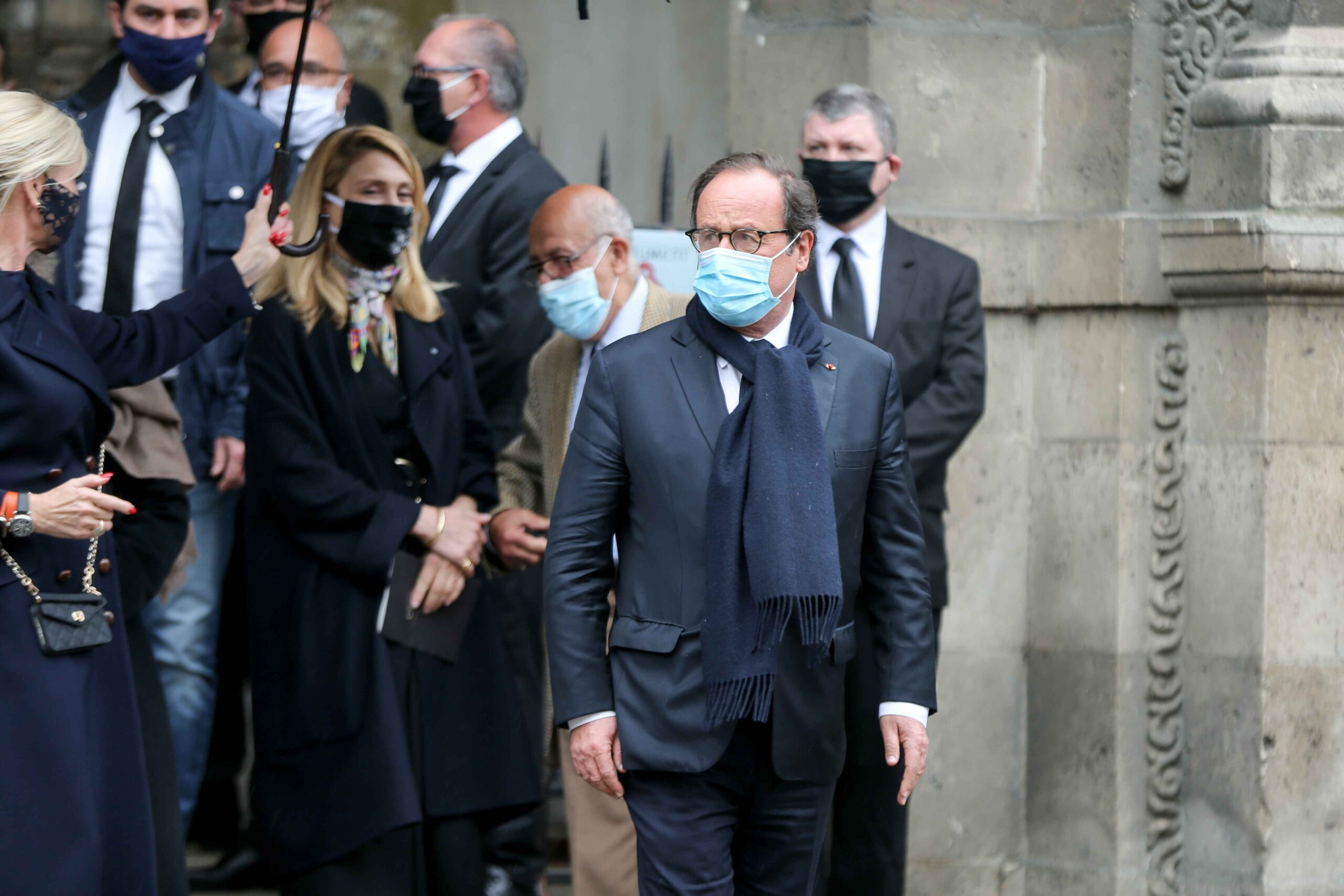 Former French President Francois Hollande (2R) and his partner French actress Julie Gayet (5R) leave after attending the funerals of French singer Juliette Greco, at the Saint-Germain-des-Pres church in Paris, on October 5, 2020. Legendary French singer Ju