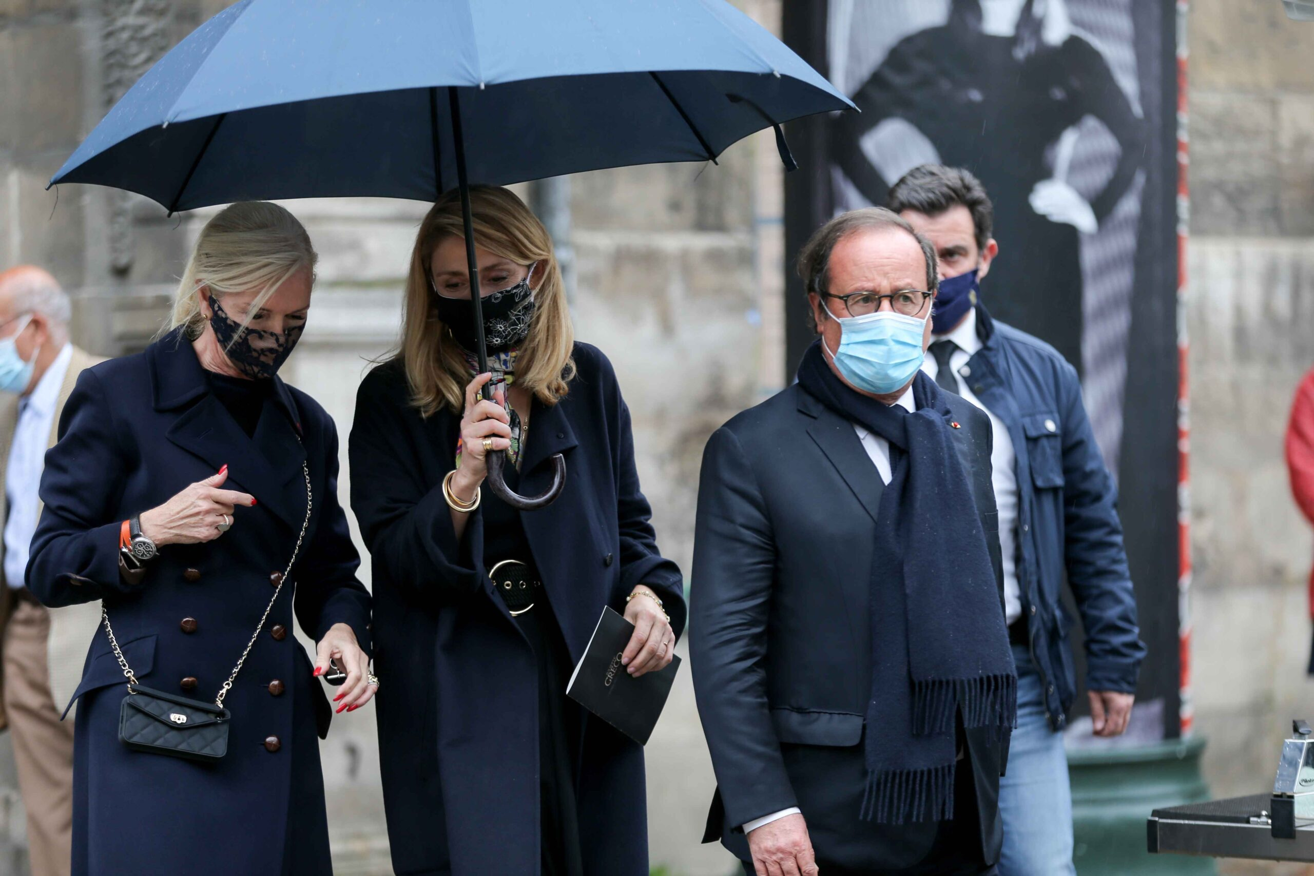 Former French President Francois Hollande (2R) and his partner French actress Julie Gayet (2L) leave after attending the funerals of French singer Juliette Greco, at the Saint-Germain-des-Pres church in Paris, on October 5, 2020. Legendary French singer Ju