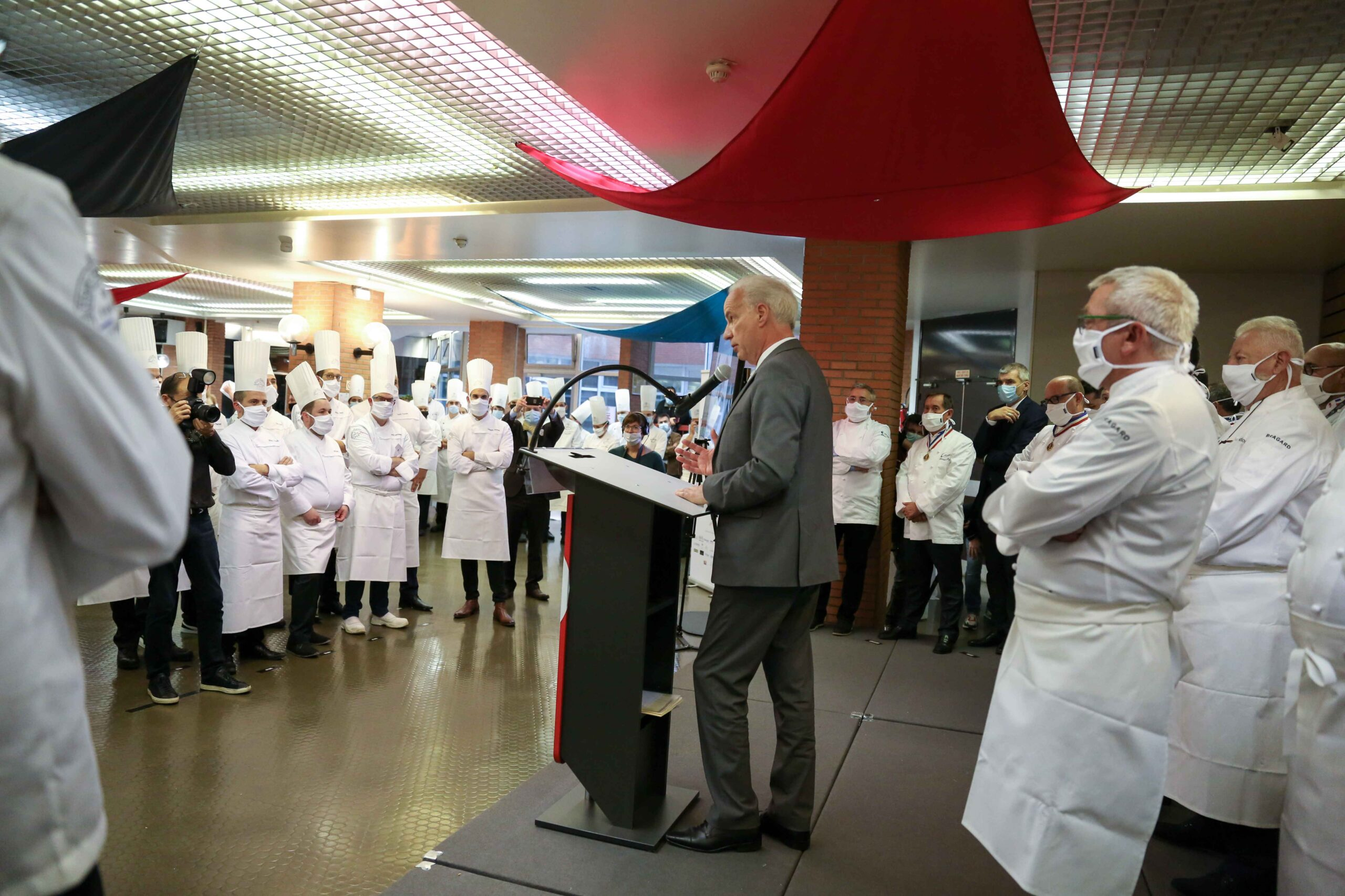 French Junior Minister of Small and Medium Entreprises Alain Griset (C) is speaking in the Culinary Professions Centre of Excellence (Centre d'excellence des professions culinaires – CEPROC) for the awards ceremony of the Grand Prix of France for artis