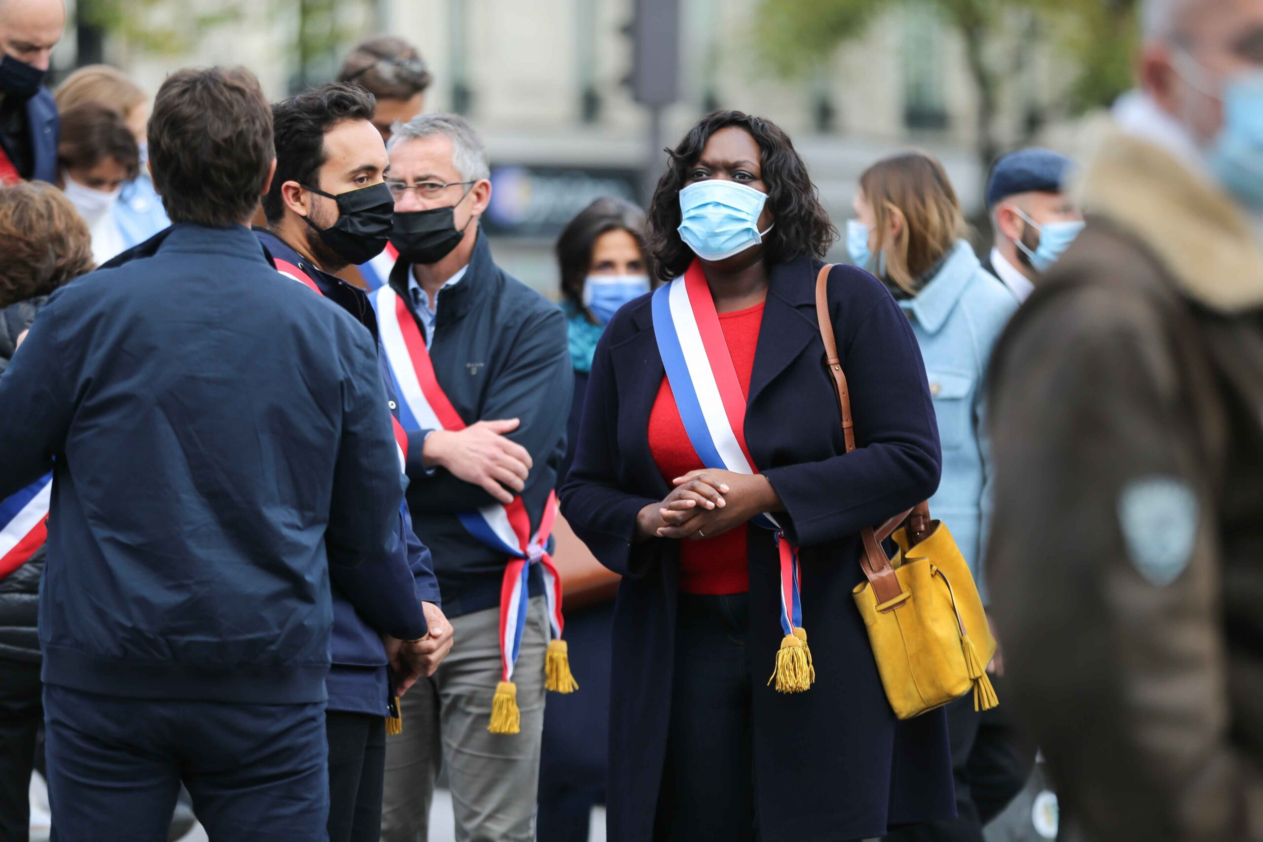 French centre-right ruling party La Republique en Marche (LREM) member of parliament Laetitia Avia (3R) stands as people gather on Place de la Republique in Paris on October 18, 2020, in homage to history teacher Samuel Paty two days after he was beheaded