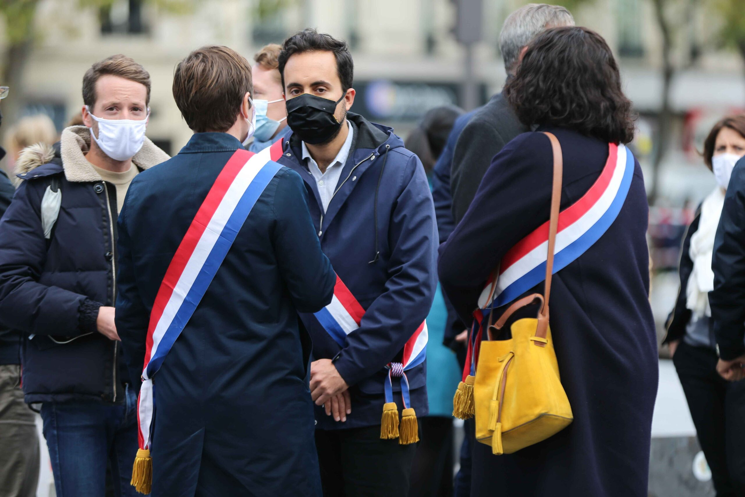 French centre-right La Republique en Marche (LREM) party member of parliament Mounir Mahjoubi  (2R) stands as people gather on Place de la Republique in Paris on October 18, 2020, in homage to history teacher Samuel Paty two days after he was beheaded by a