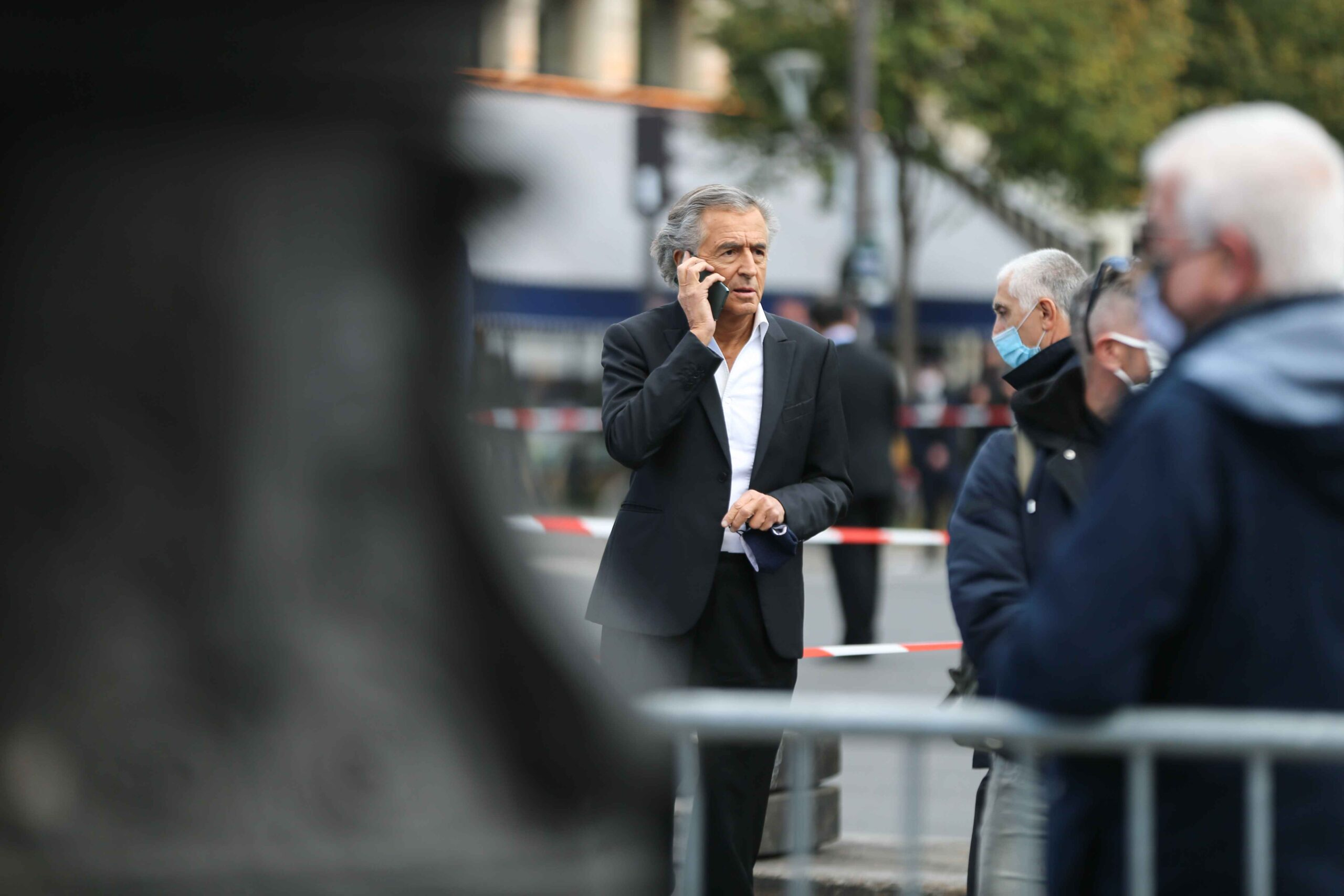 French philosopher and co-screenwriter Bernard-Henry Levy (C) stands as people gather on Place de la Republique in Paris on October 18, 2020, in homage to history teacher Samuel Paty two days after he was beheaded by an attacker who was shot dead by police