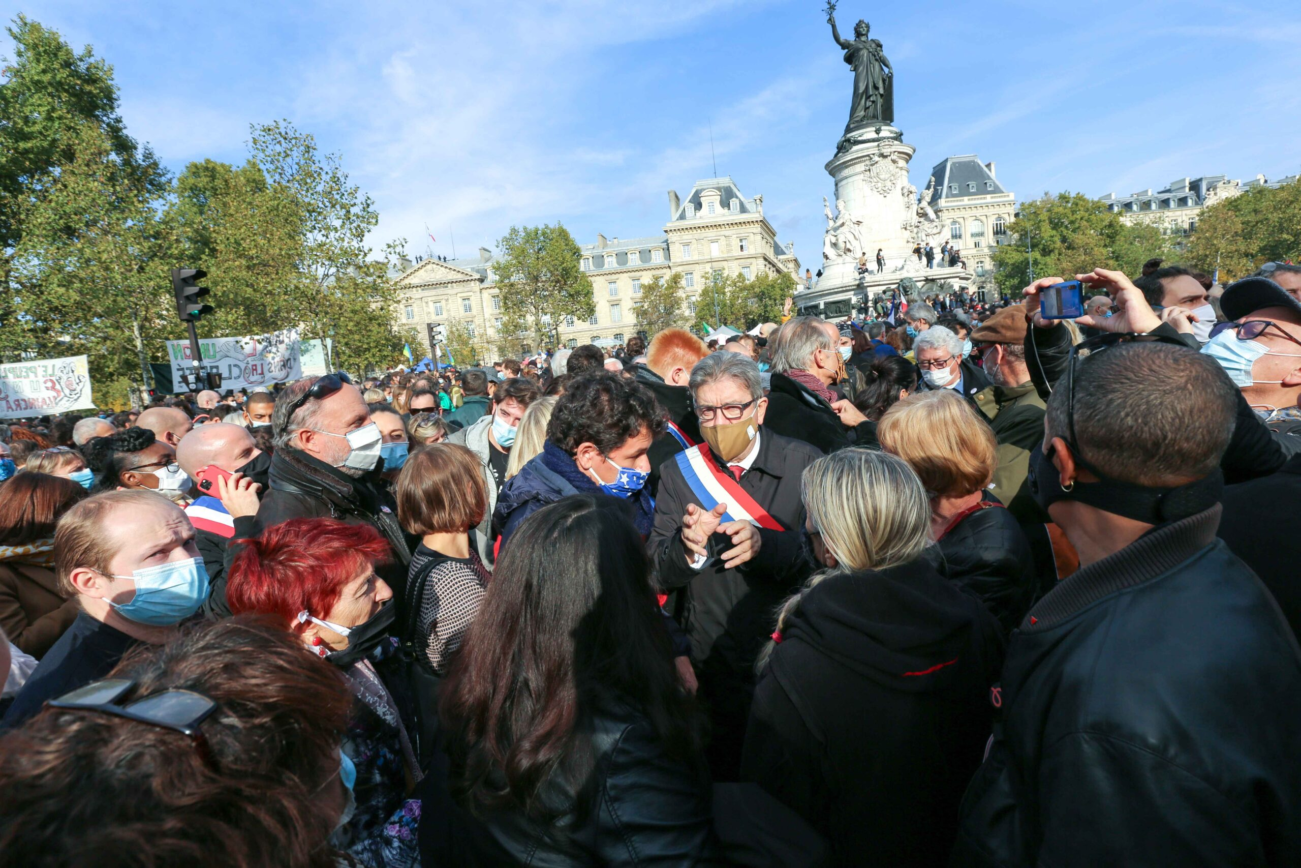 French leftist party La France Insoumise's (LFI) member Jean-Luc Melenchon as people  gather on Place de la Republique in Paris on October 18, 2020, in homage to history teacher Samuel Paty two days after he was beheaded by an attacker who was shot dead