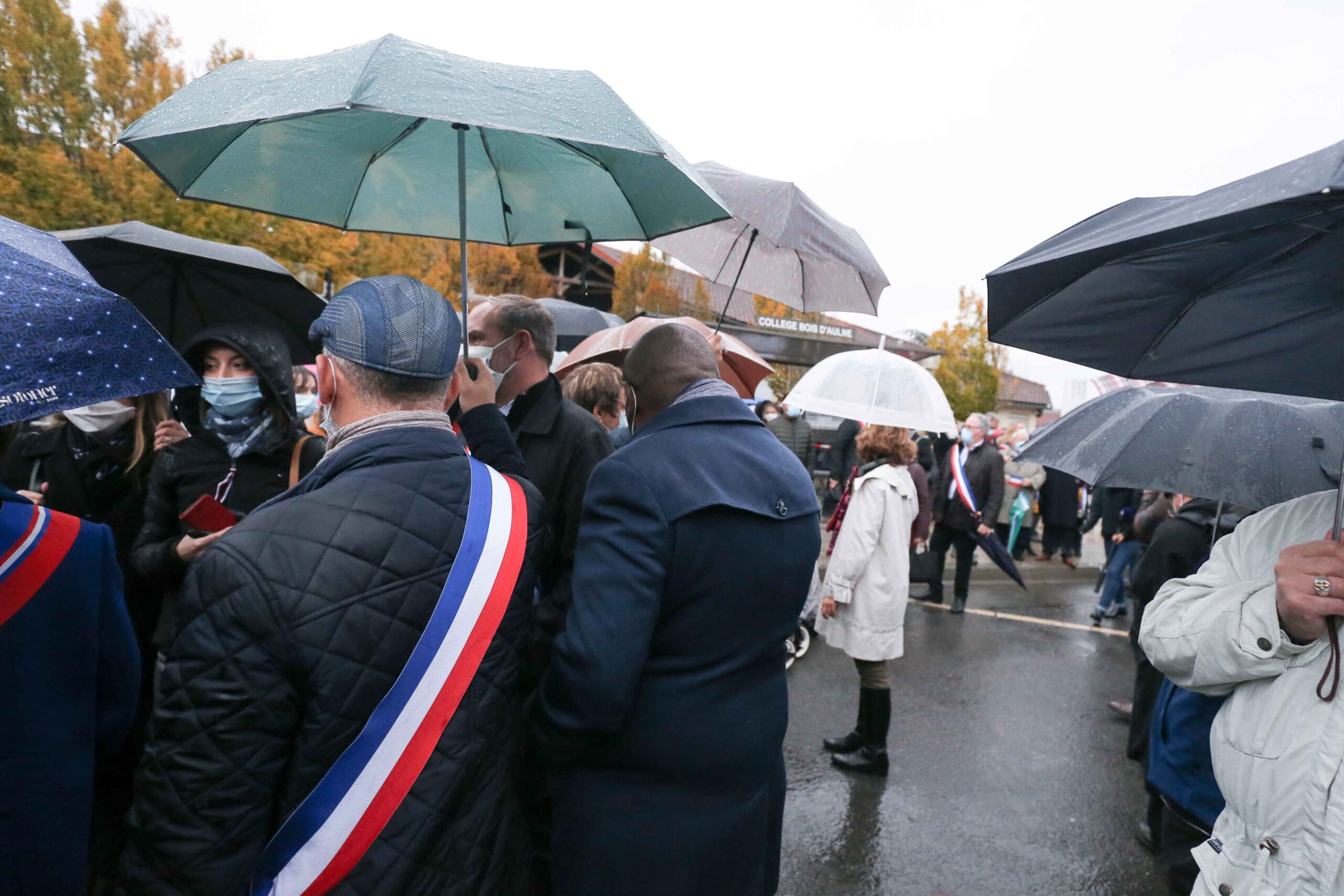 Elected representatives gather at the middle school in Conflans-Sainte-Honorine, northwest of Paris, on October 20, 2020 during the 'Marche Blanche' in solidarity after a teacher was beheaded for showing pupils cartoons of the Prophet Mohammed. His murder