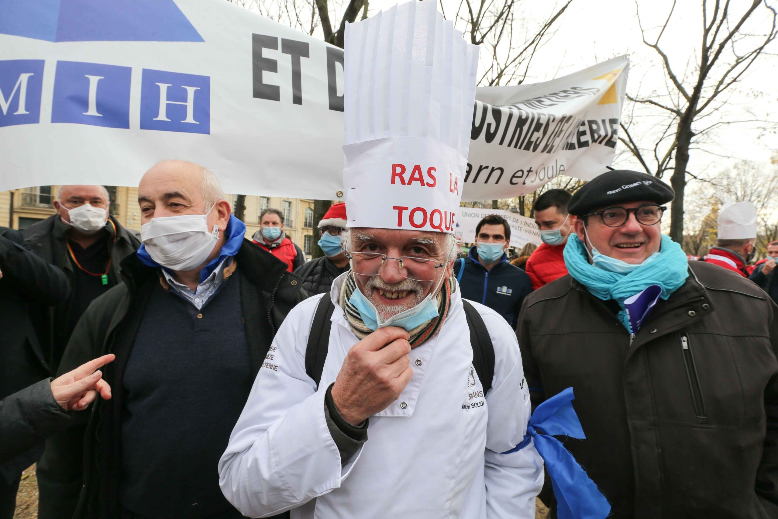 "A protester wears a hat reading the slogan ""I'm sick"" on December 14, 2020 in Paris during a demonstration of hotel and restaurant owners as well as tourism professionals to demand their businesses to reopen amidst the Covid-19 pandemic, caused by the no"