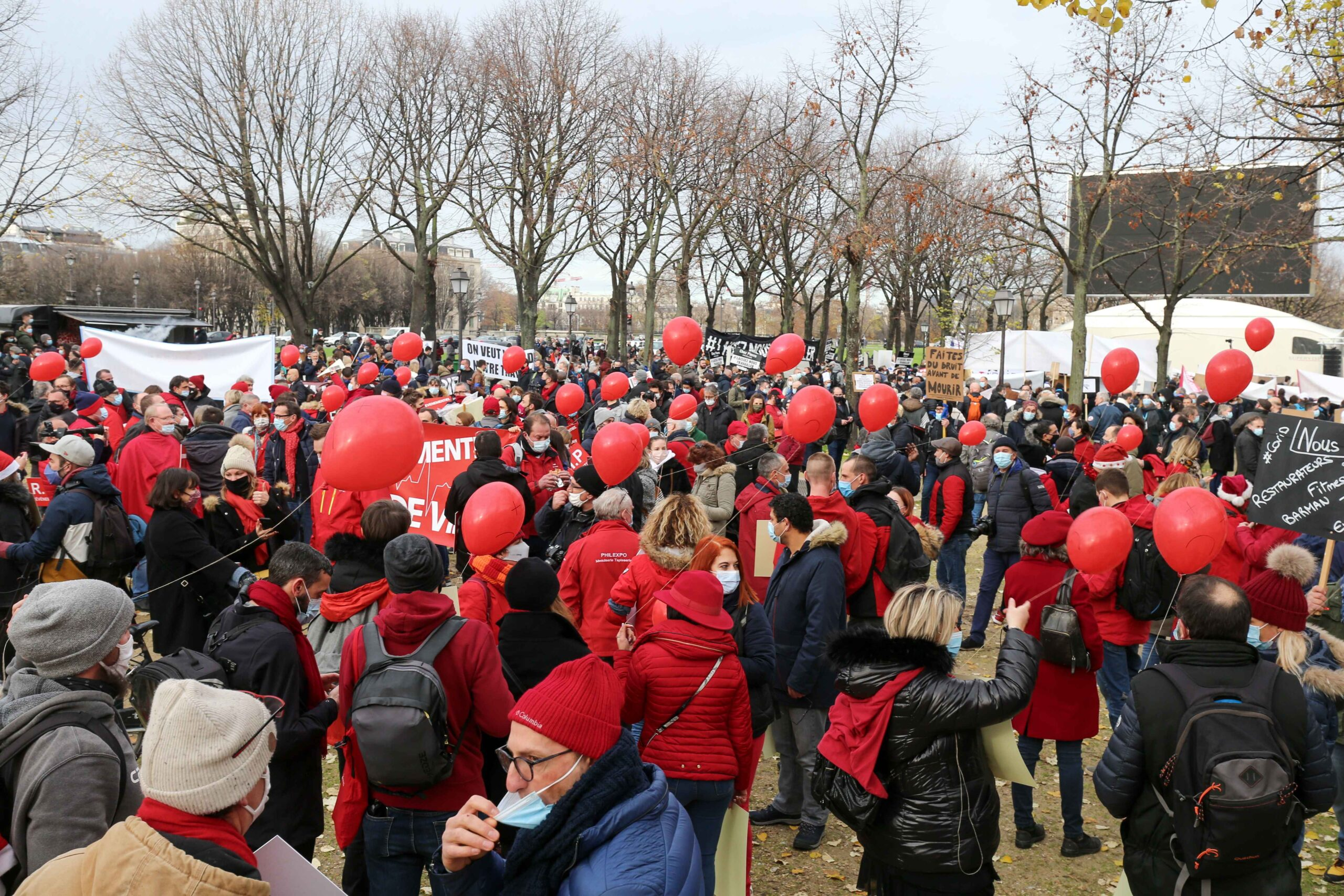 Protesters gather on the Invalides esplanade on December 14, 2020 in Paris during a demonstration of hotel and restaurant owners as well as tourism professionals to demand their businesses to reopen amidst the Covid-19 pandemic, caused by the novel coronav