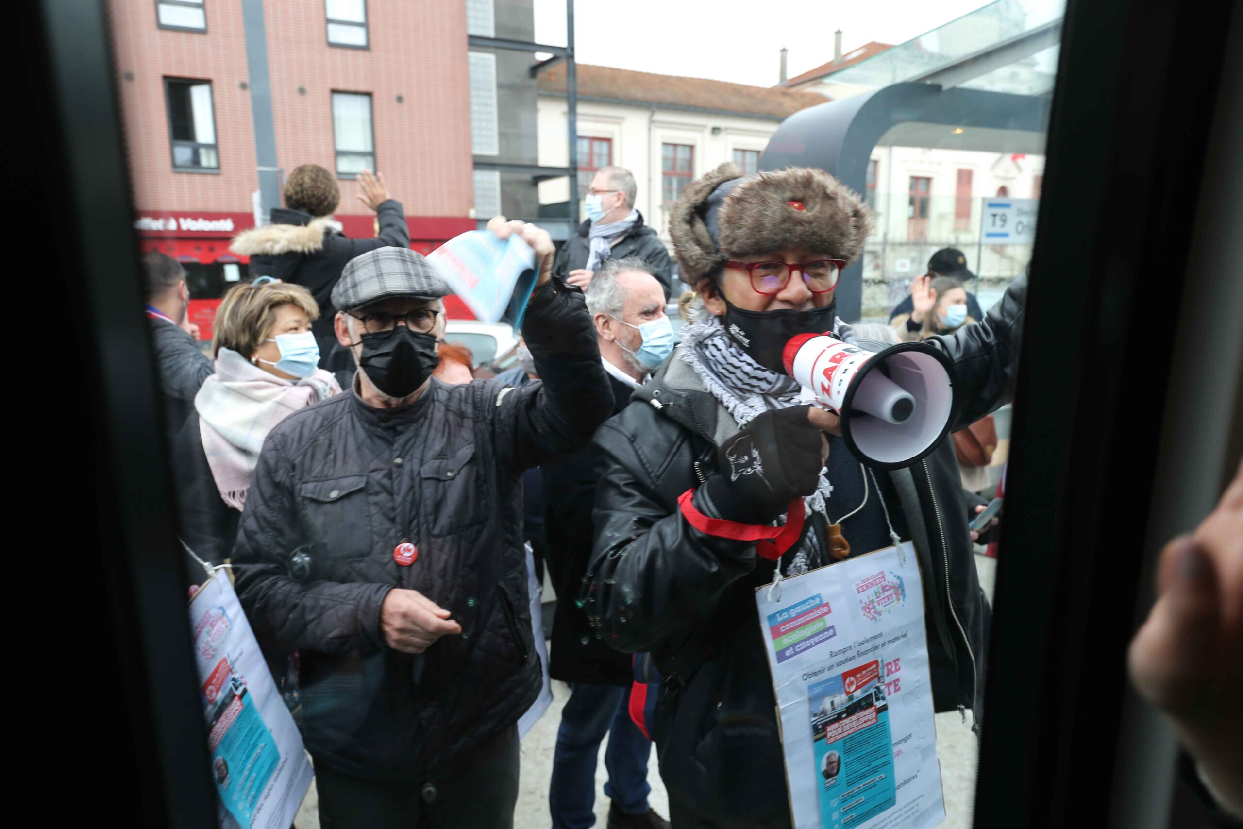 Opponents usin a magaphone demonstrate during the opening day of the new tramway T9 tram line between Porte de Choisy and Orly City, southeastern Paris, on April 10, 2021 in Vitry-sur-Seine, southeastern Paris.Line T9 connects Porte de Choisy Paris Métr