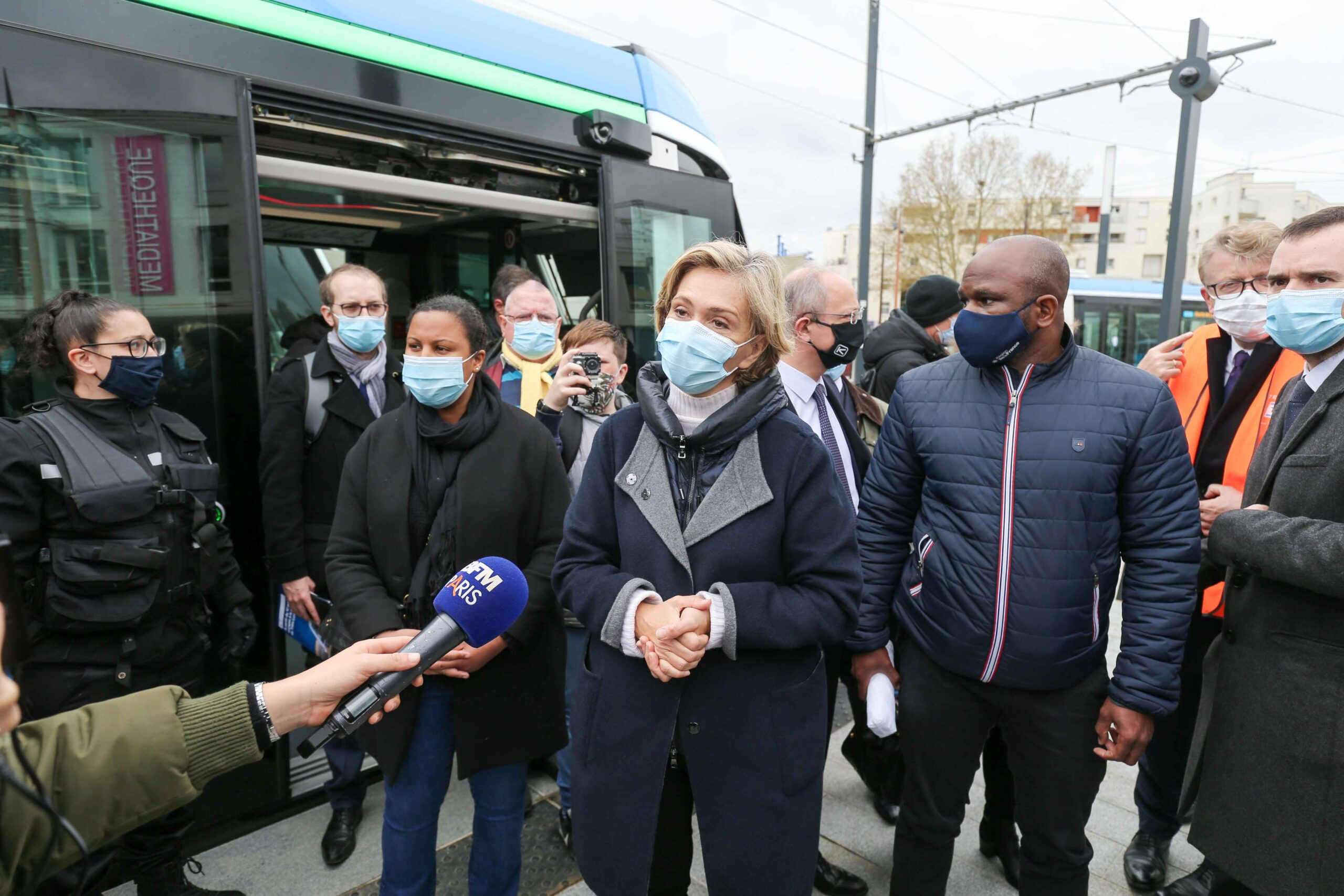 President of the French region of Ile-de-France Valerie Pecresse (C) speaks with the press as she  inaugurates the new tramway T9 tram line between Porte de Choisy and Orly City, southeastern Paris, on April 10, 2021 at Porte de Choisy, in Paris.Line T9