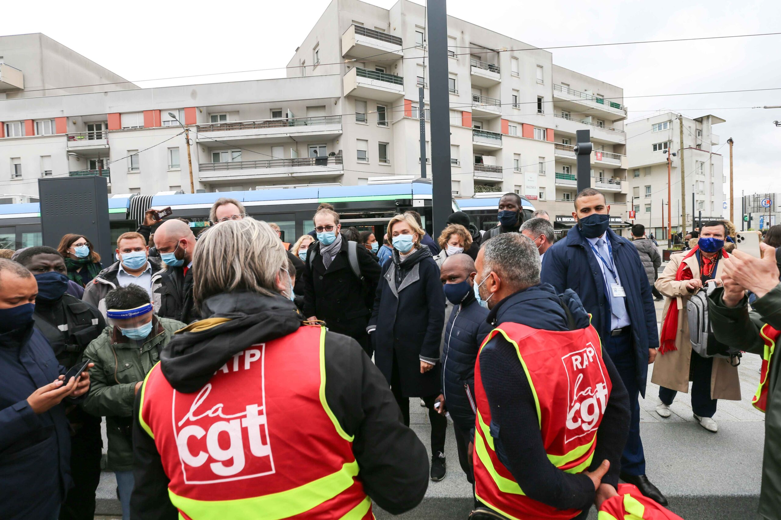 President of the French region of Ile-de-France Valerie Pecresse (C) speaks with CGT unionists  as she  inaugurates the new tramway T9 tram line between Porte de Choisy and Orly City, southeastern Paris, on April 10, 2021 at Orly City.Line T9 connects Po