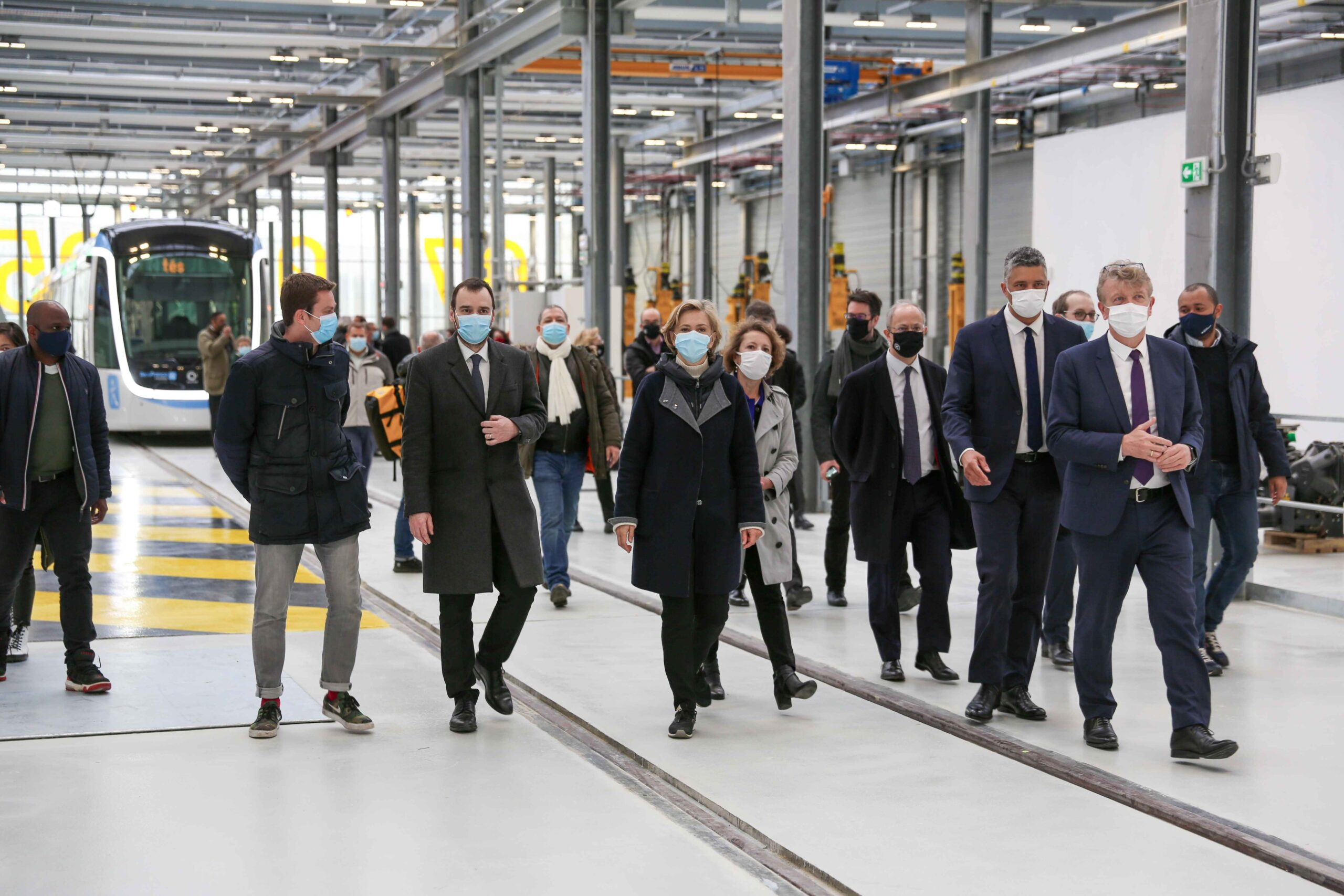 President of the French region of Ile-de-France Valerie Pecresse (C) visits the repair facilities of the the new tramway T9 tram line between Porte de Choisy and Orly City, southeastern Paris, on April 10, 2021 at Orly City, during the open day of the lin