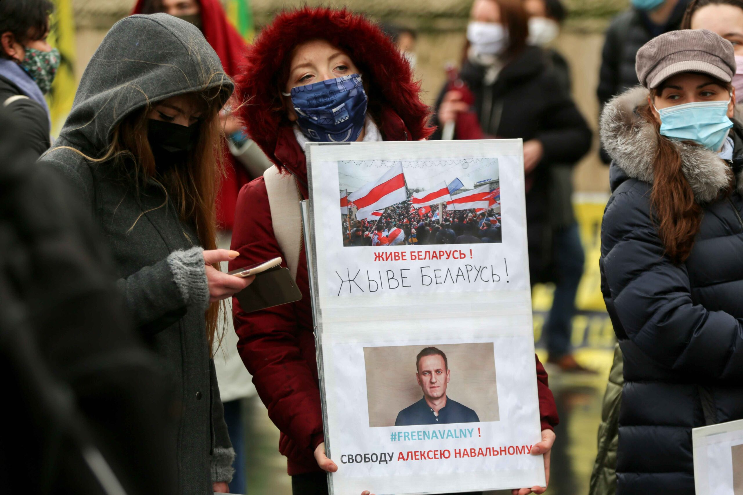 "A protester holds a placard reading ""Freedom to Alexei Navalny"" during a rally in support of jailed opposition leader Alexei Navalny in place du Trocadéro, in Paris on January 23, 2021. Navalny, 44, was detained last Sunday upon returning to Moscow after"