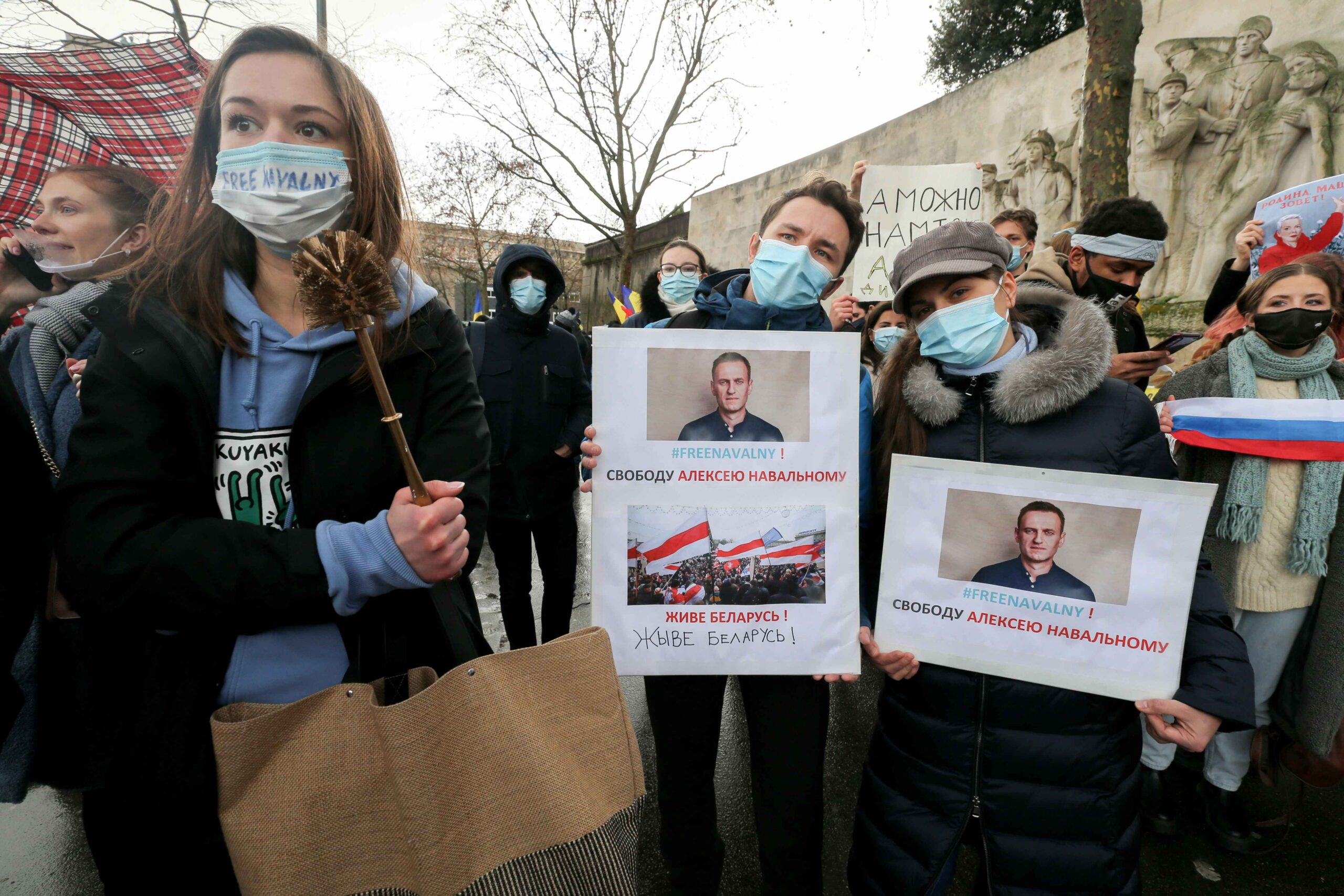 "Protesters hold placards reading ""Freedom to Alexei Navalny"" during a rally in support of jailed opposition leader Alexei Navalny in place du Trocadéro, in Paris on January 23, 2021. Navalny, 44, was detained last Sunday upon returning to Moscow after fiv"