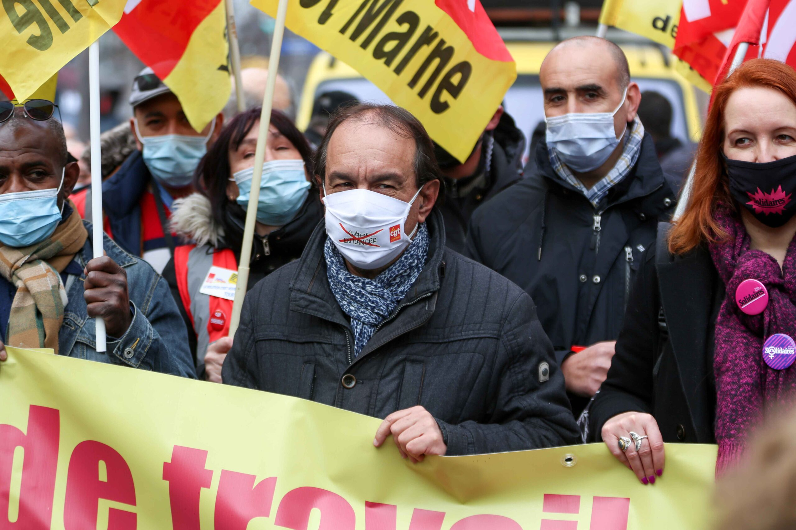 French CGT trade union General Secretary Philippe Martinez (C) joins a protest during a day of action to highlight the current economic and cultural difficulties being experienced across France as the coronavirus (Covid-19) pandemic continues on February 4