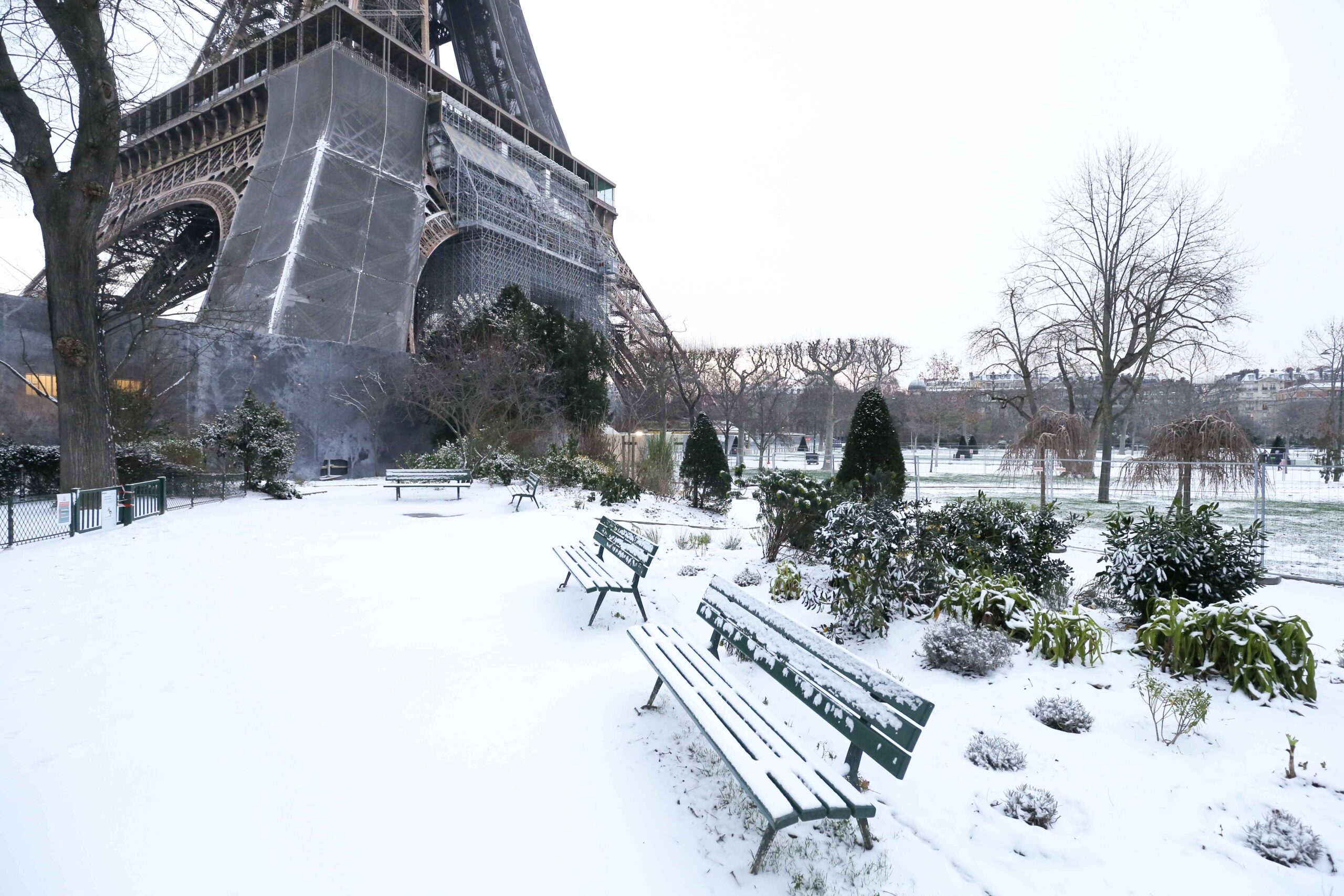 Gardens beneath the Eiffel Tower, in Paris, are covered in snow on February 10, 2021, following an overnight snowfall. In parts of the Paris region authorities cancelled school buses and urged parents to keep children at home. The city of Paris has opened