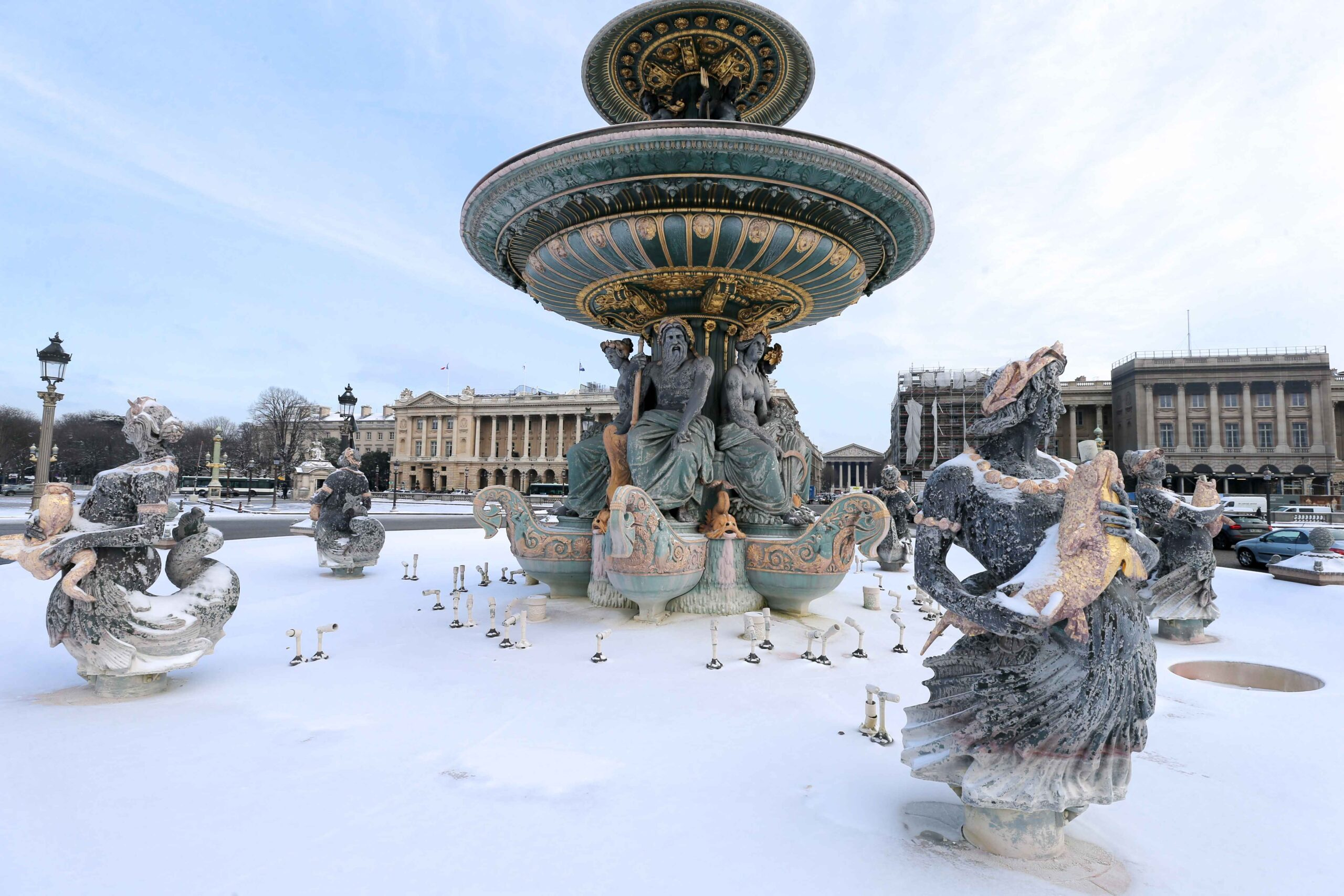 Basins and jets of water of the Place de la Concorde, in Paris, are covered in snow on February 10, 2021, following an overnight snowfall. In parts of the Paris region authorities cancelled school buses and urged parents to keep children at home. The city