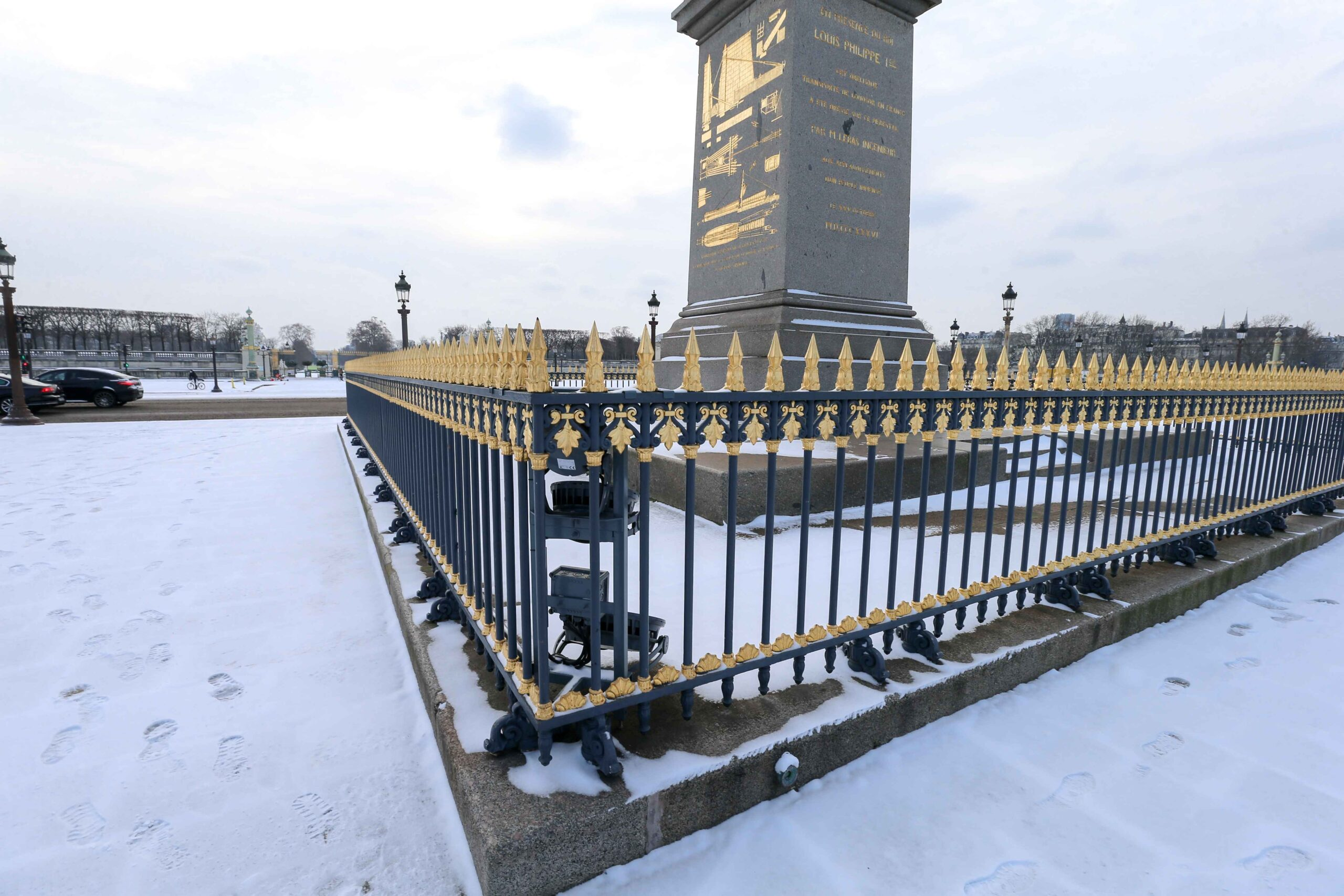 The foot of the Obelisk of the Place de la Concorde, in Paris, are covered in snow on February 10, 2021, following an overnight snowfall. In parts of the Paris region authorities cancelled school buses and urged parents to keep children at home. The city o