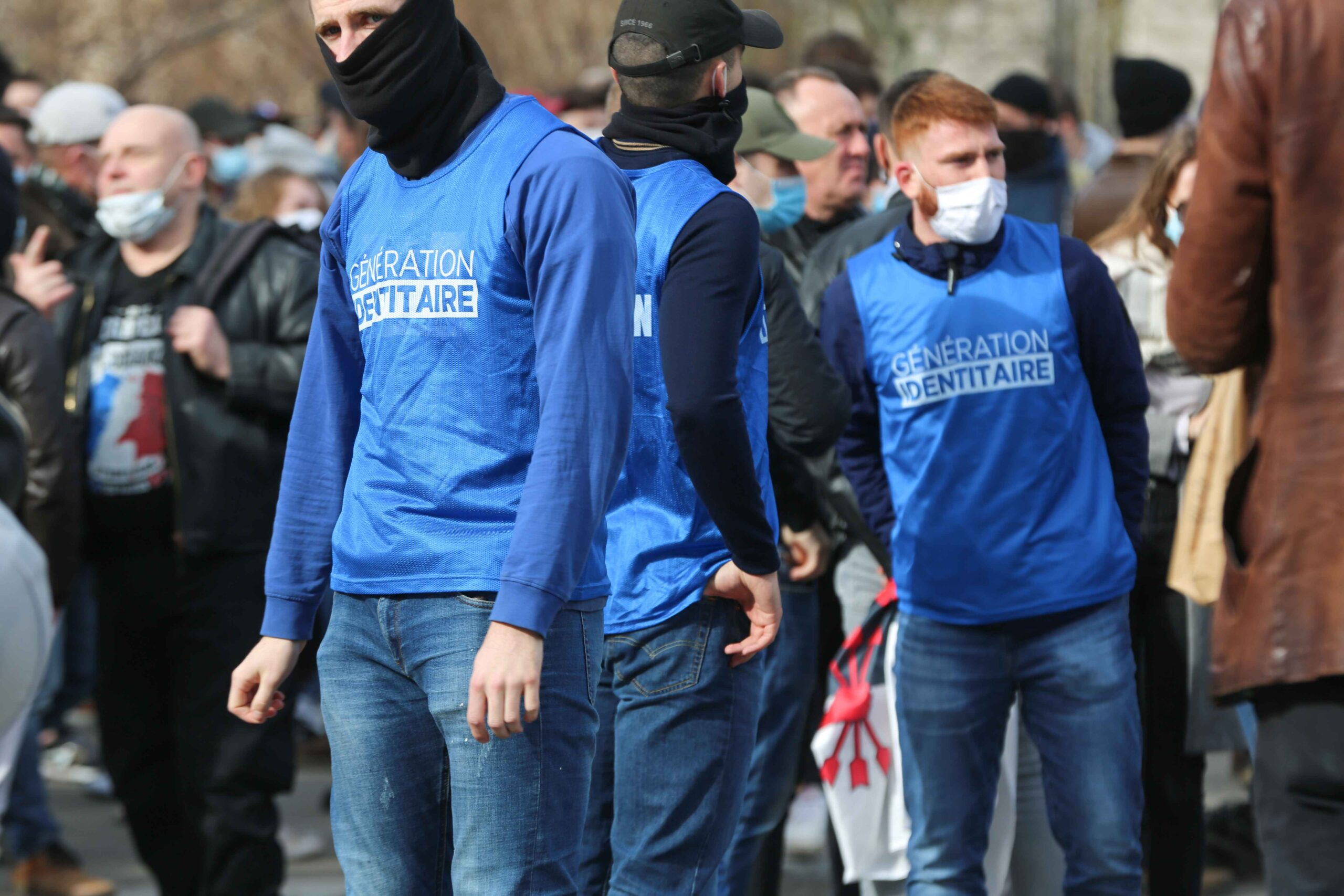 Members of far right group Generation Identitaire (GI) wear a t-shirt with the name of the group during a protest against its potential dissolutionin in Place Denfert Rochereau, in Paris  on February 20, 2021. The dissolution of Generation identitaire was