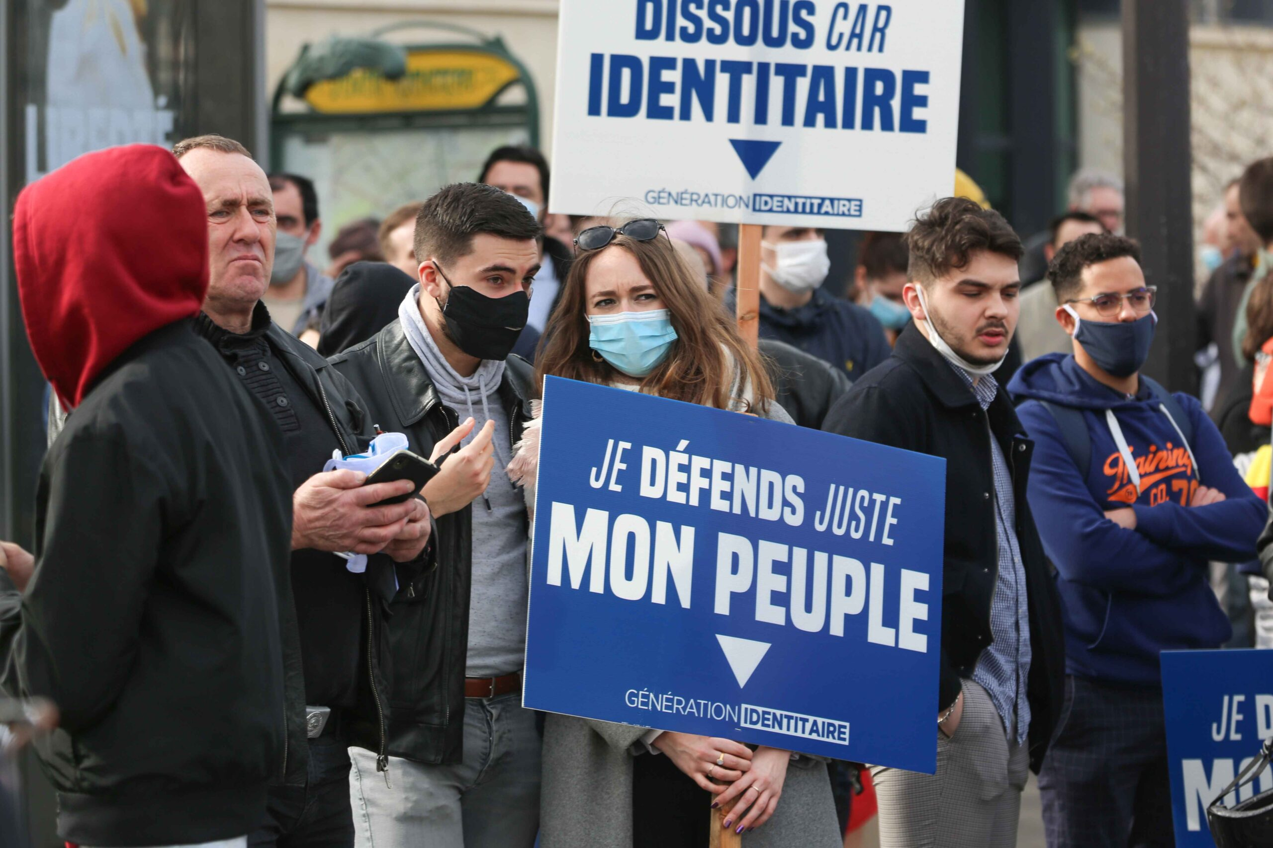 A member of far right group Generation Identitaire (GI) holds a placard reading « I'm just defending my people » during a protest against its potential dissolution in Place Denfert Rochereau, in Paris on February 20, 2021. The dissolution of Generation