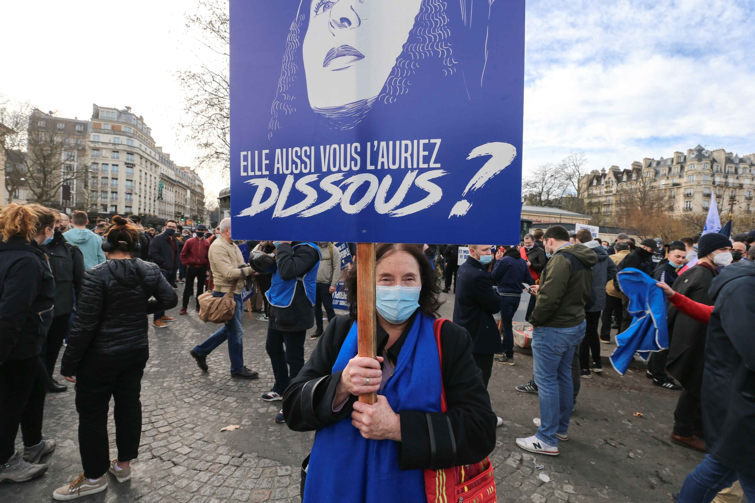 Member of far right group Generation Identitaire (GI) holds a placard with the portrait of Joan d'Arc and reading « you also would have dissolved it ? » during a protest against its potential dissolution in Place Denfert Rochereau, in Paris on February